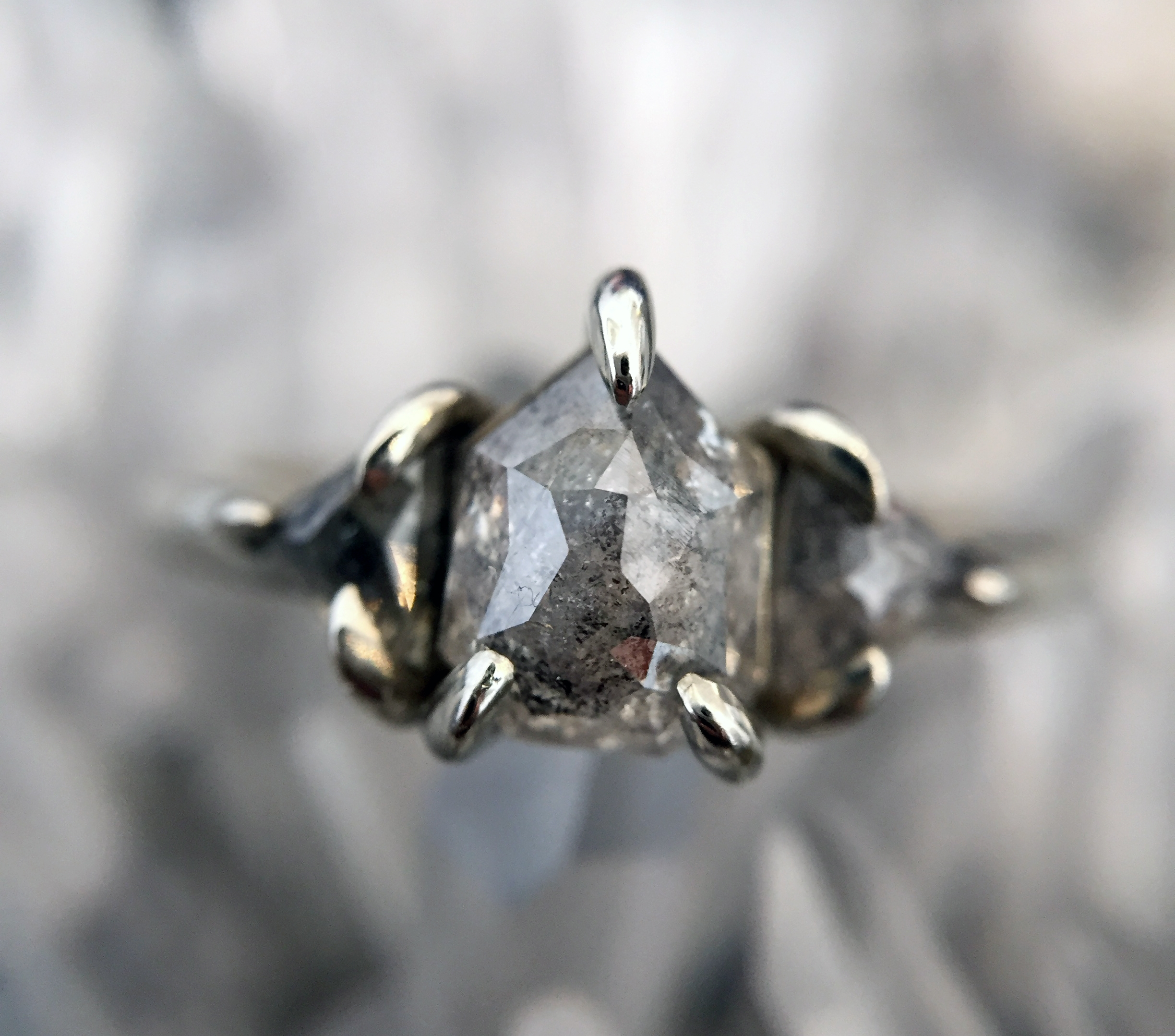 THE bullet RING - Ice her out with this white gold x salt and pepper diamond stunner. Featuring a bullet-cut center diamond, accompanied by matching trillion sides, this is a super unique take on the classic three stone ring.