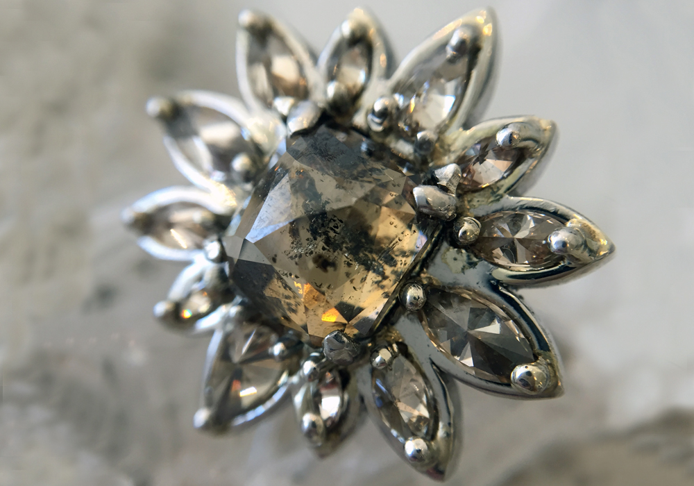 FIELD OF DREAMS - Like a sparkling sunflower radiating forth from a Van Gogh painting, this floret includes a 3.18ct ambrosial cognac center diamond wreathed by no less than 12 marquise diamond petals. The perfect statement ring to symbolize your blossoming love.