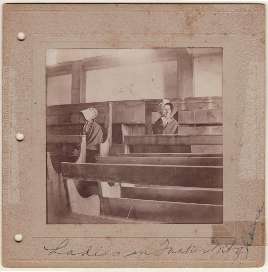 Quaker women inside Meeting House