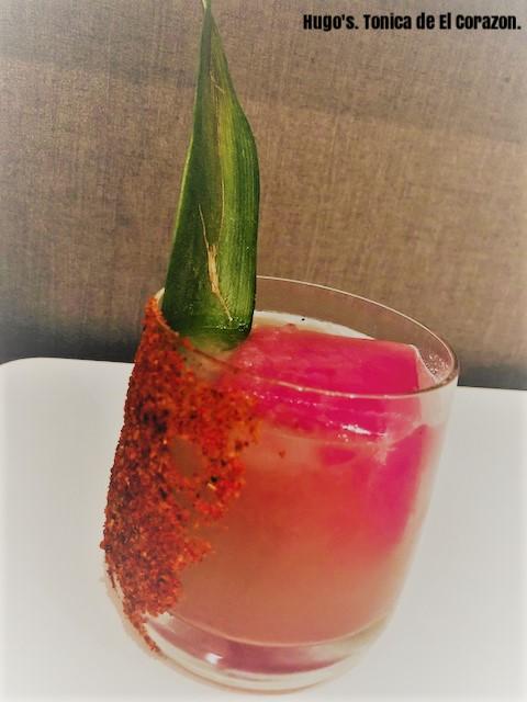 Hugo's. Tonica de El Corazon. Fever Tree citrus tonic, hibiscus ice cube, lime, piloncillo syrup, roasted pineapple juice, jalapeno..png