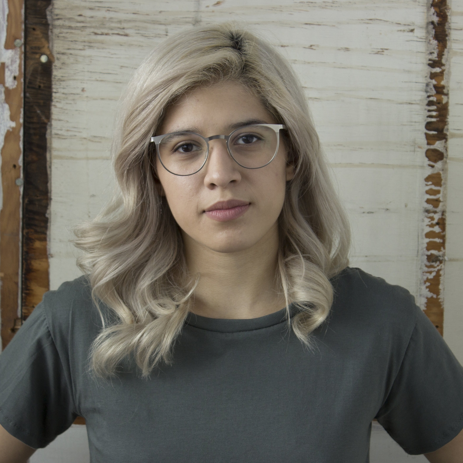 Graphic Designer  Carolina Alatriste  Carolina was born and raised in the south side of Chicago. She recently graduated from the University of Illinois at Chicago with a Bachelor of design in graphic Design. She's currently trying to figure out how to survive life after college.