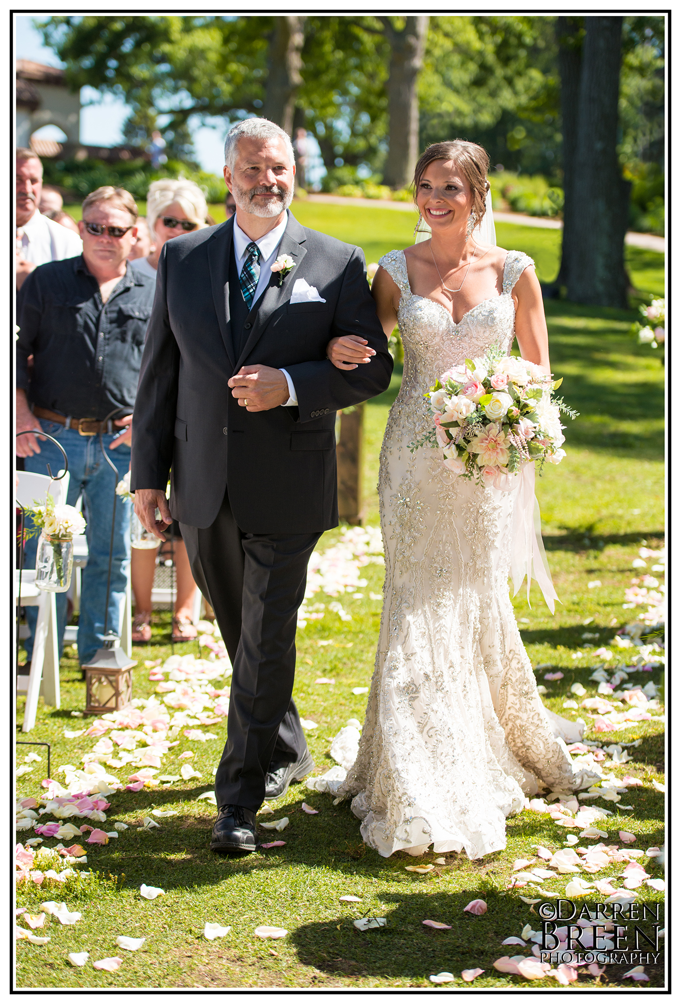 Wedding photos of Genevieve Nelson and Braydon Soule in Spring Lake and Grand Haven June 10, 2017.