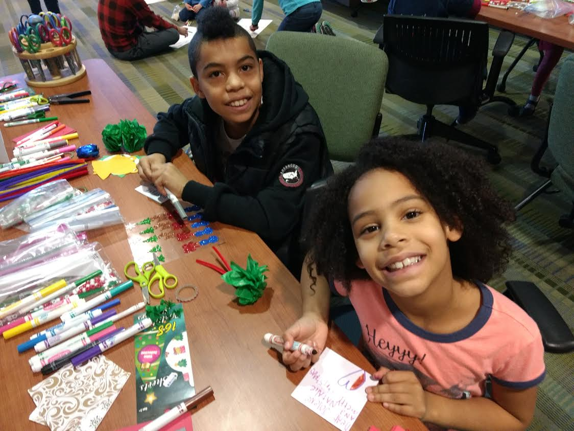 Maddox and Lillian volunteer with Seeds of Caring