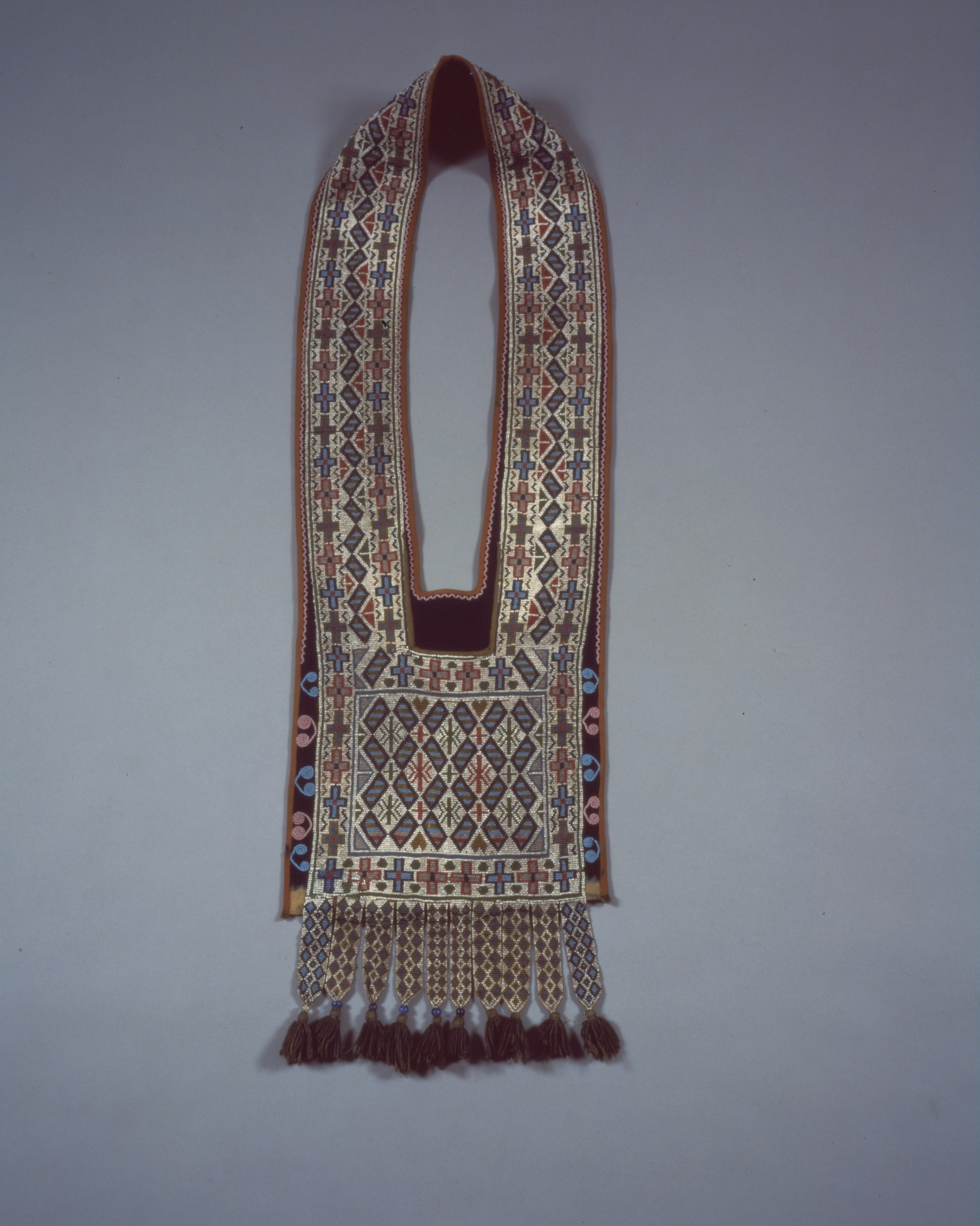 Potawatomi, bandolier bag, about 1890. Red trade cloth; cotton print; and white, green, black, red, pumpkin, and blue-gray glass beads, 33 7/16 × 12 3/16 in. Hood Museum of Art, Dartmouth College: Bequest of Frank C. and Clara G. Churchill; 46.17.9843.