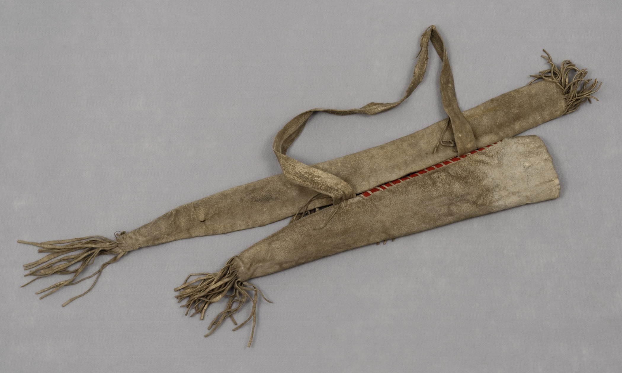 Sioux,bow case and quiver, 1877–79. Leather, red wool cloth, and rawhide. Hood Museum of Art, Dartmouth College: Gift of Edward W. Bush, Jr., Class of 1945, Tuck 1947; 47.12.10804.