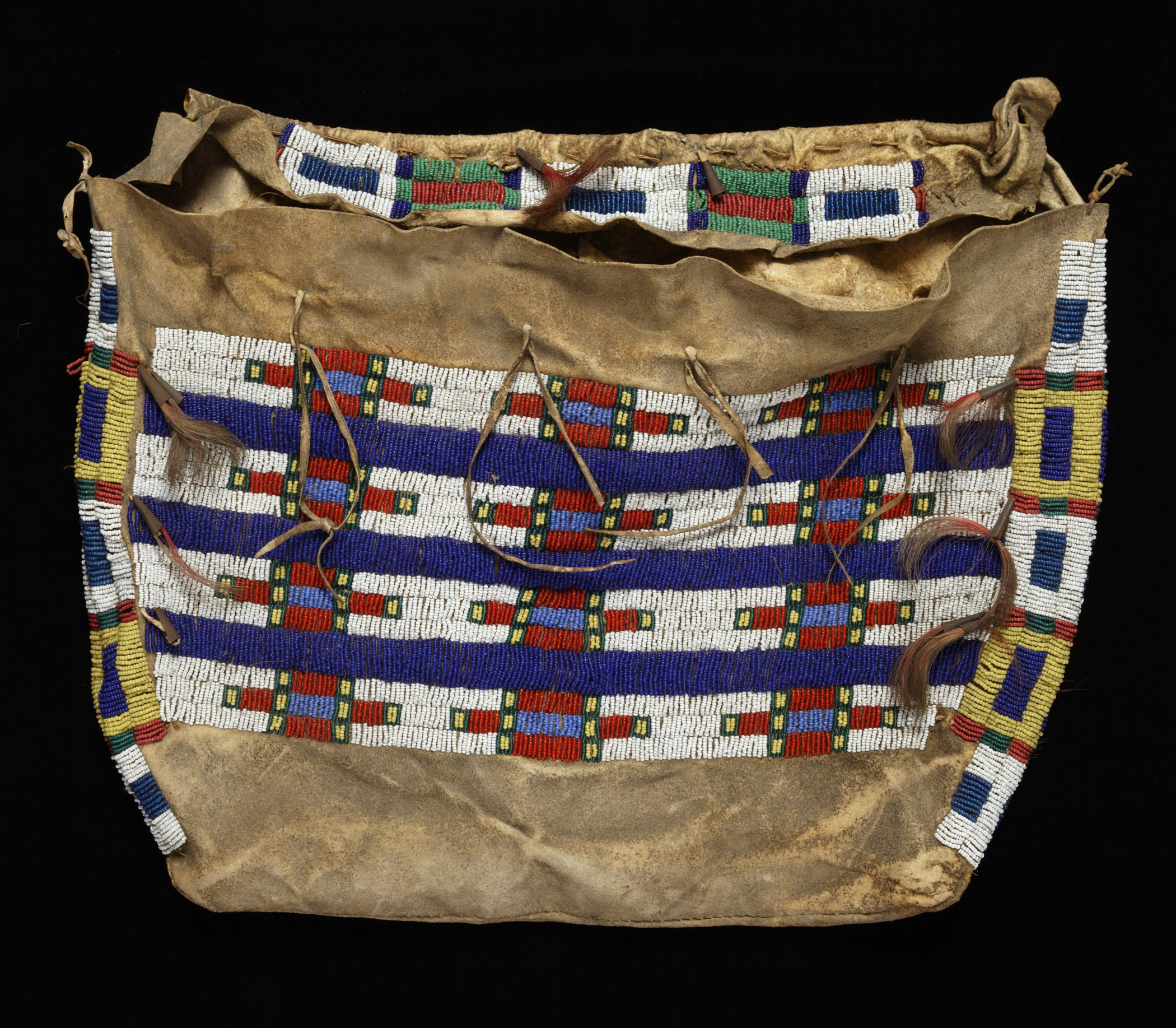 Lakota (Teton Sioux), tipi bag (possible bag), about 1890–1910. Buffalo (American bison) hide, glass beads, metal (tin) cones, sinew, cloth, string, and dyed horsehair tufts, 15 1/4 × 19 1/4 × 1 1/2 in. Hood Museum of Art, Dartmouth College: Gift of Robert G. Sands, Class of 1959, Tuck 1960; 2010.45.