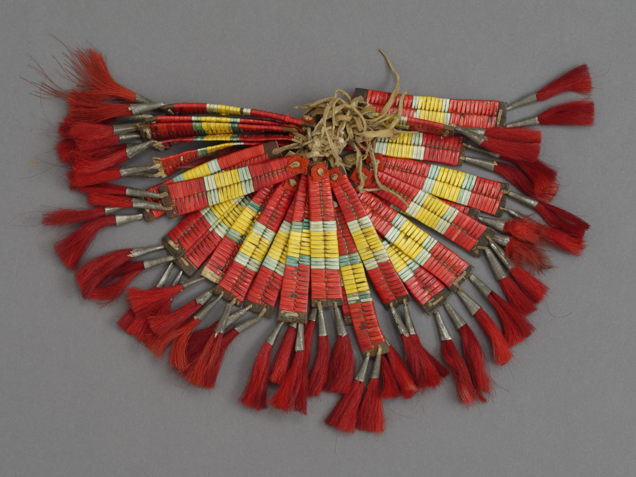 Unknown people (Plains), 26 tipi ornaments, early 20th century. Commercial leather, quills, metal, and horsehair, 5 7/8 × 13/16 in. Hood Museum of Art, Dartmouth College: Gift of Guido R. Rahr, Sr., Class of 1951P; 985.47.26614.