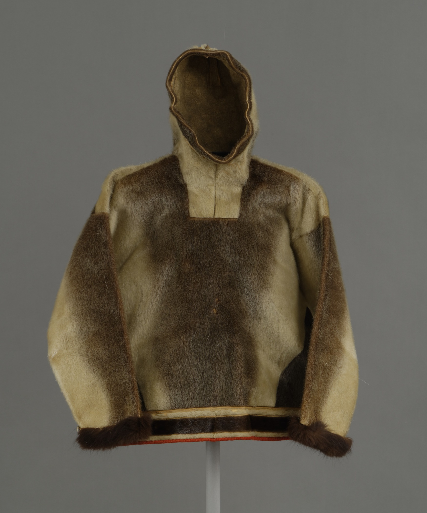 Kalaallit (West Greenlandic Inuit),men's hooded parka for spring and summer, about 1897. Sealskin, dog fur cuffs, sinew, and cloth, height: 36 1/4 in. Hood Museum of Art, Dartmouth College: Gift of Mrs. William Stickney, Class of 1900W; 164.21.15428.