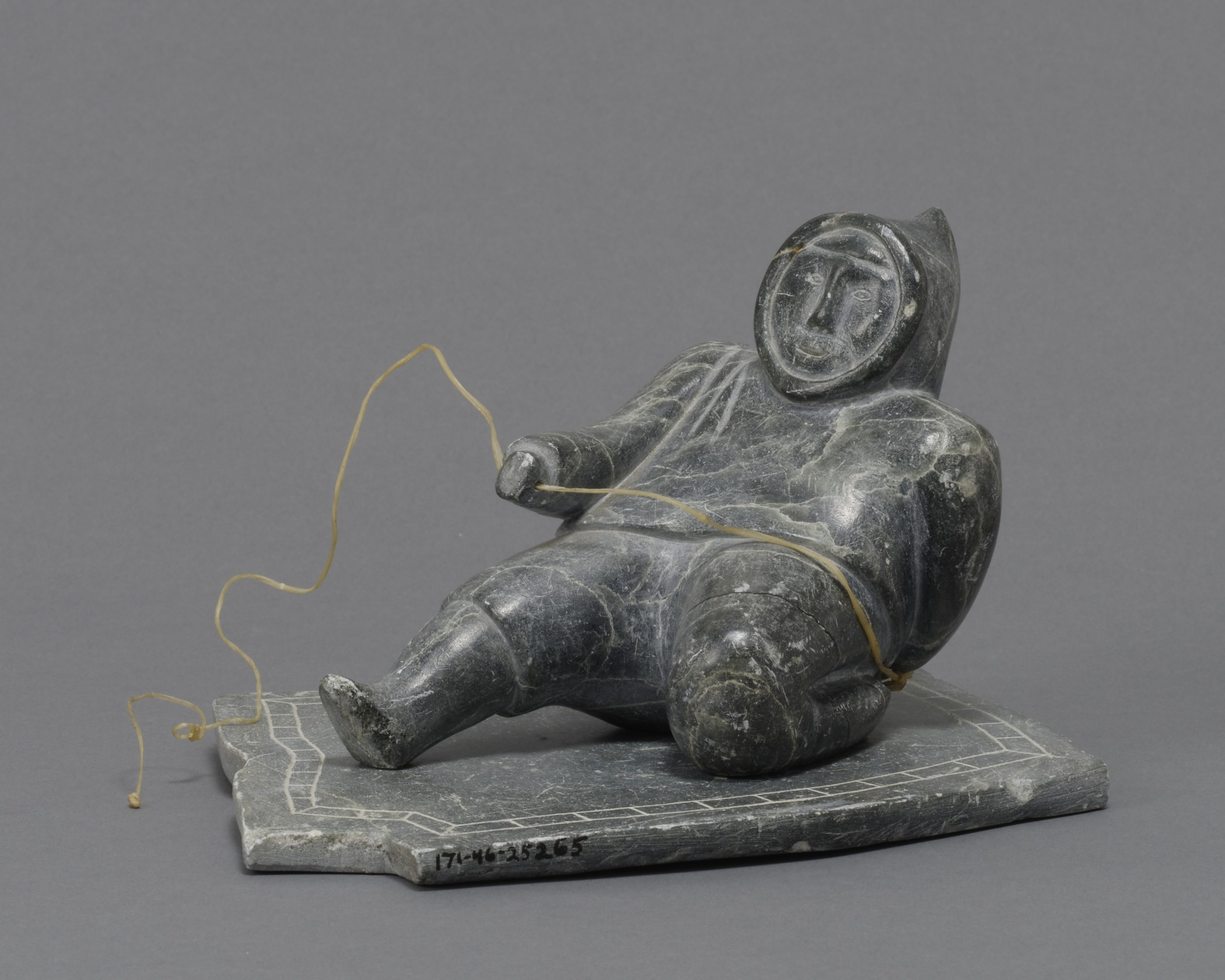 Canadian (Inuit), Hunting a Seal , early 1950s. Steatite and ivory, 3 3/4 × 3 7/16 in. Hood Museum of Art, Dartmouth College: Gift of Louise Potter; 171.46.25265.