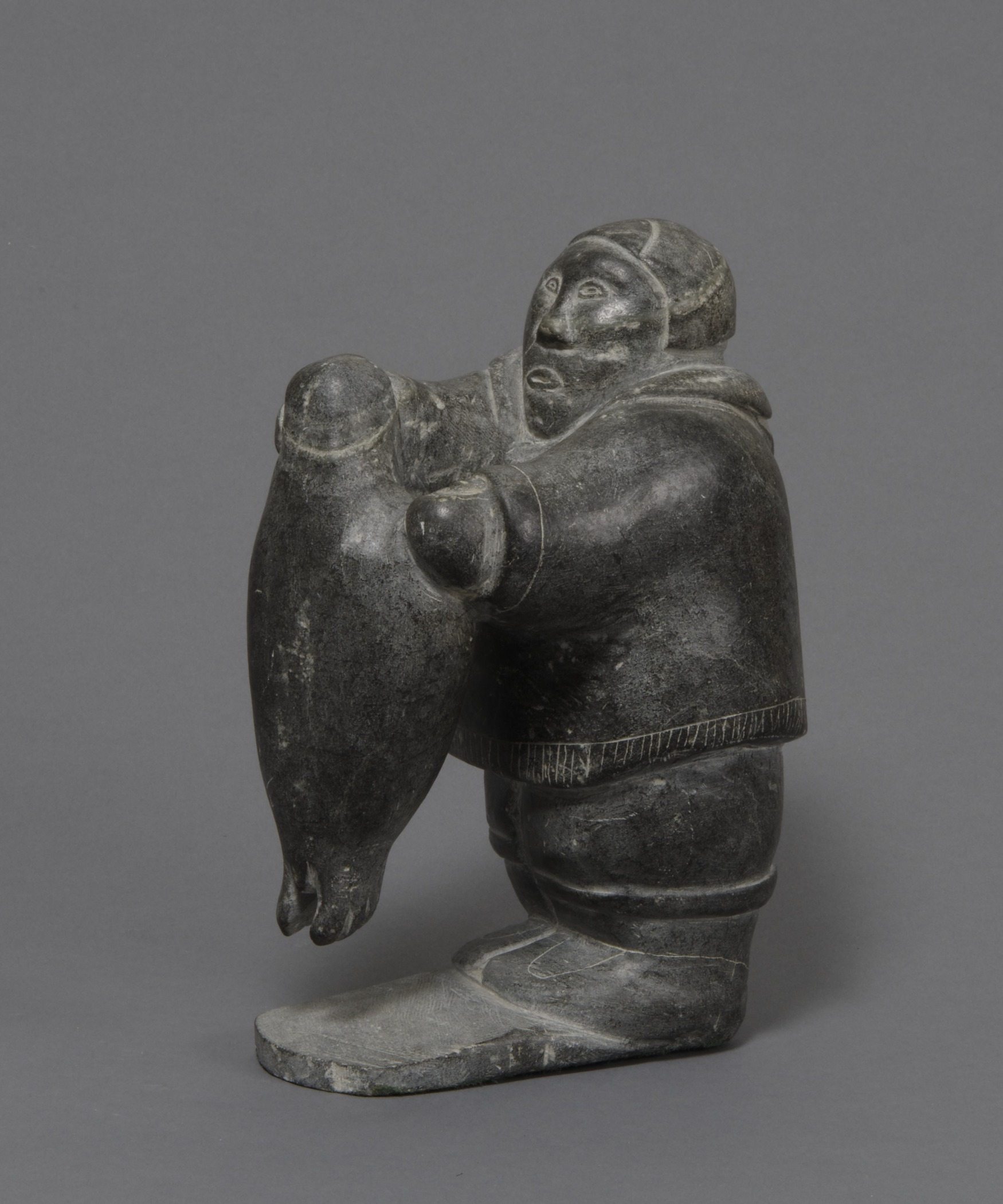 Canadian (Inuit), An Inuk Pulling a Seal out of the Water , about 1955. Steatite and felt , 9 7/16 × 4 9/16 × 6 7/16 in. Hood Museum of Art, Dartmouth College: Gift of Willy E. Gorrissen; 179.17.25857.