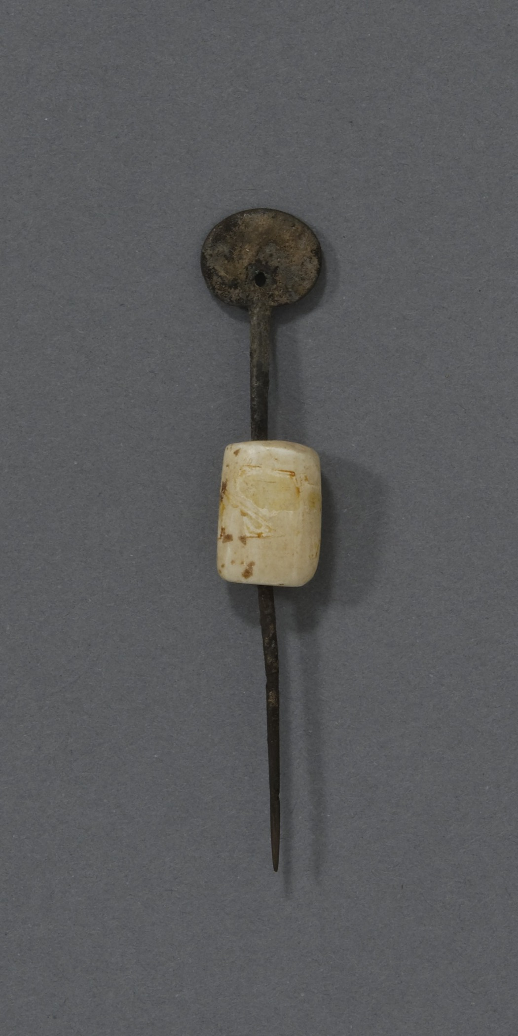 Kitlinermiut (Copper Inuit), woman's sewing awl with a round bone guard, collected 1953–62. Copper and bone, height: 3 15/16 in. Hood Museum of Art, Dartmouth College: Sherman P. and Anne L. Haight Arctic Collection; 168.94.24463.