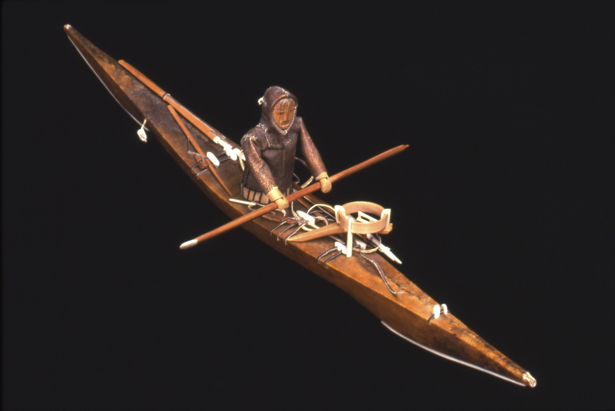 Kalaallit (West Greenlandic Inuit), souvenir model kayak with paddler and seal-hunting equipment, collected 1935–40. Skin, wood, and ivory, length: 16 15/16 in. Hood Museum of Art, Dartmouth College: Gift of David C. Nutt, Class of 1941; 159.9.14390.