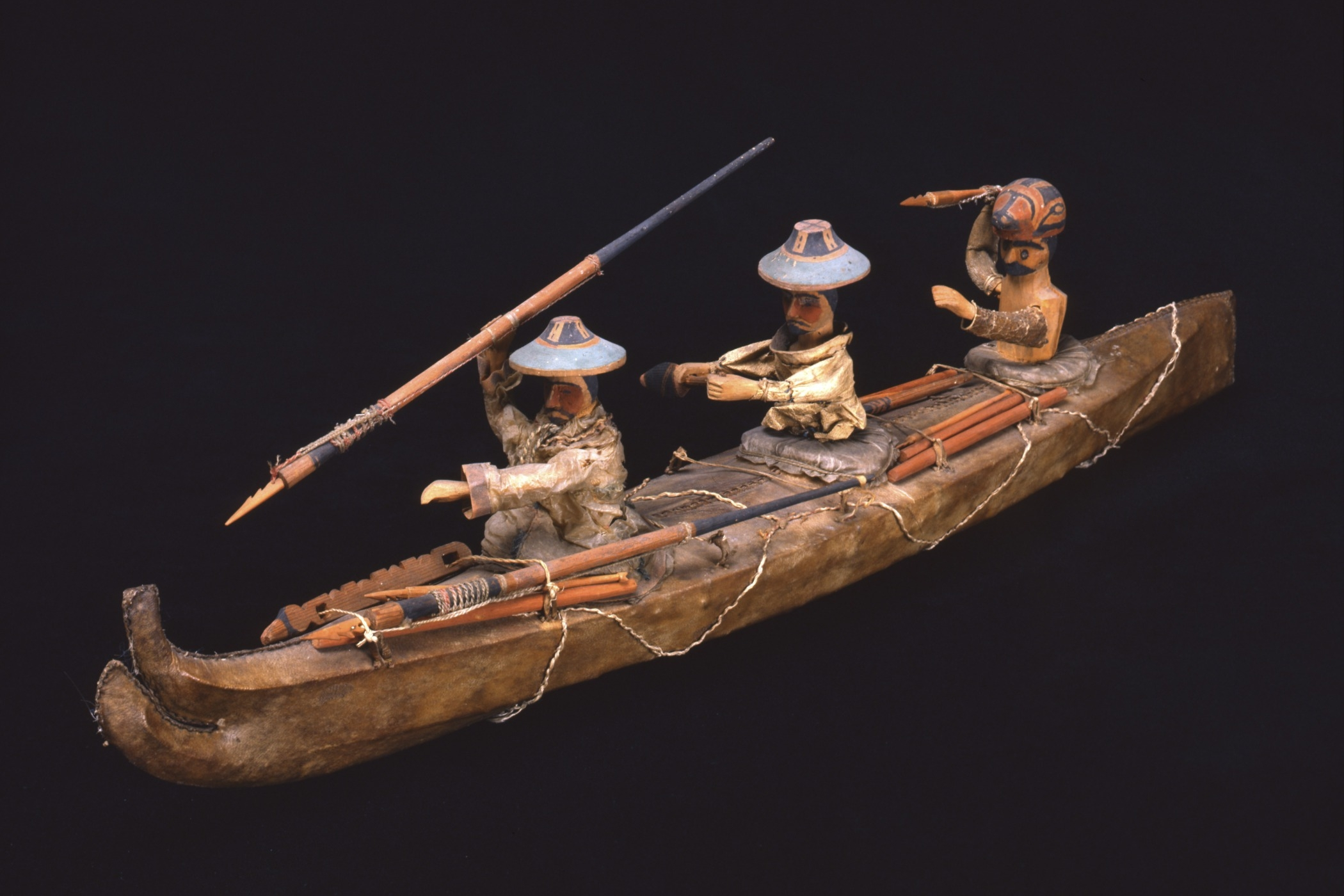Sugpiaq (Alutiiq), three-hatch kayak model, mid-19th century. Skin kayak cover, wood, gut (intestines), sinew, and pigment, 55 1/2 × 11 5/8 × 7 13/16 in. Hood Museum of Art, Dartmouth College: Gift of Captain Worthen Hall and Polly D. Lovewell Hall; 13.1.591.