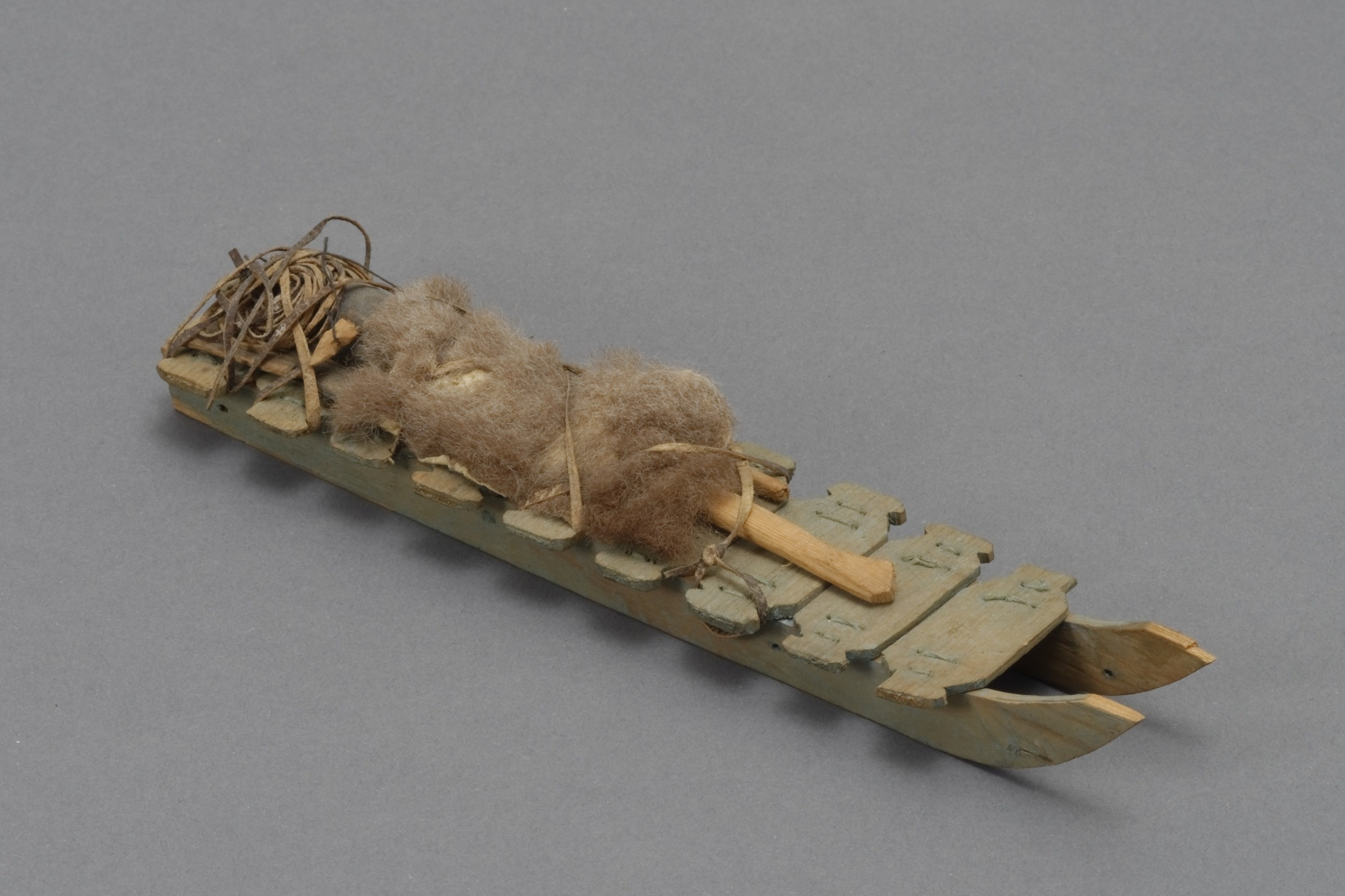 Canadian (Inuit), model sled, collected 1929–30. Wood, fur, leather, and thread, 3/4 × 1 9/16 × 6 15/16 in. Hood Museum of Art, Dartmouth College: Gift of Robert O. Fernald, Class of 1936; 158.25.14218.