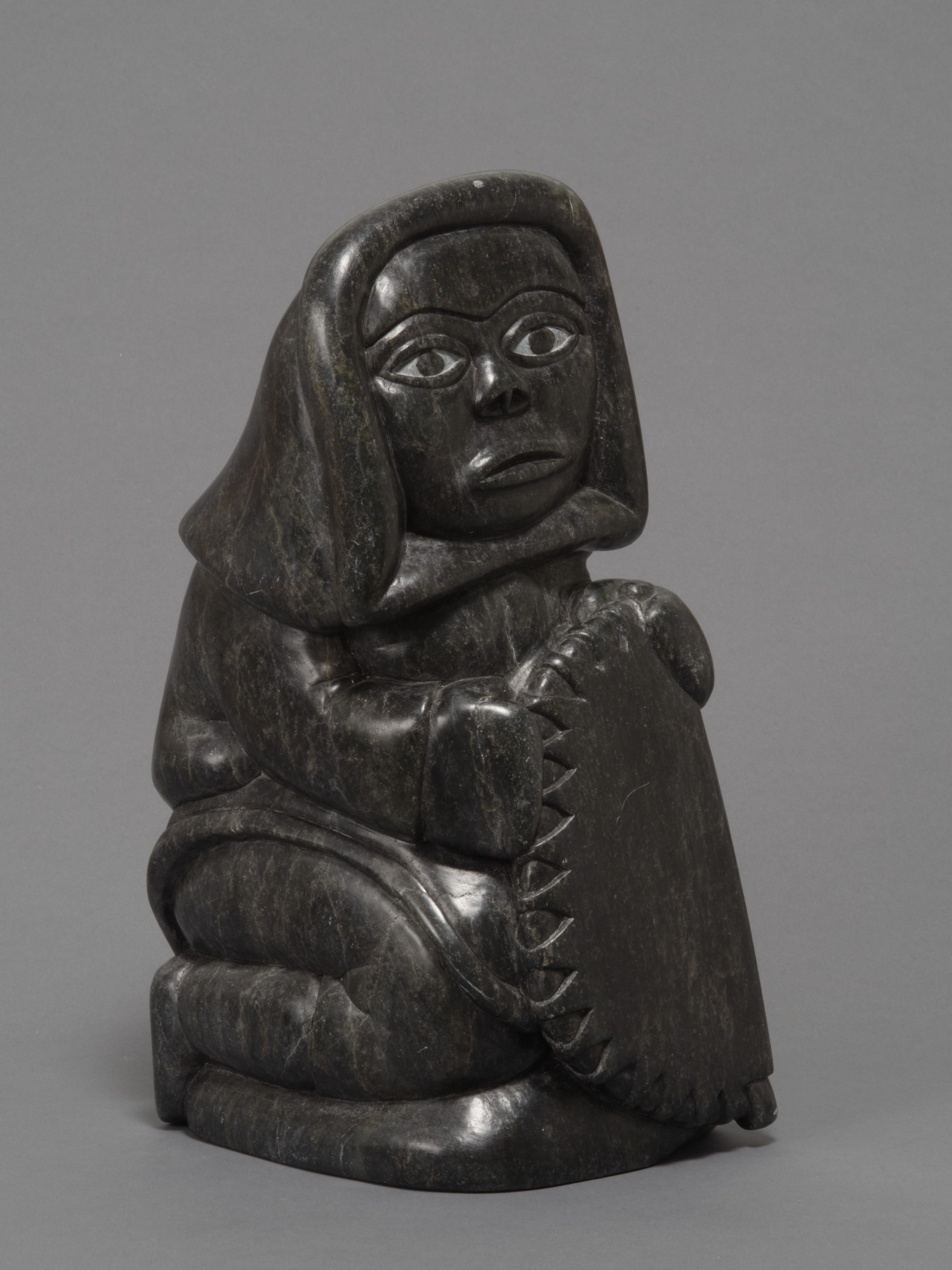 Abraham Pov, Canadian (Inuit; Povungnituk [Puvirnituq] / Inukjuak), 1927–1994,  Woman , 1982. Steatite stone, 13 3/4 × 5 7/8 × 6 11/16 in. Hood Museum of Art, Dartmouth College: Gift of Jane and Raphael Bernstein; 2011.64.35.