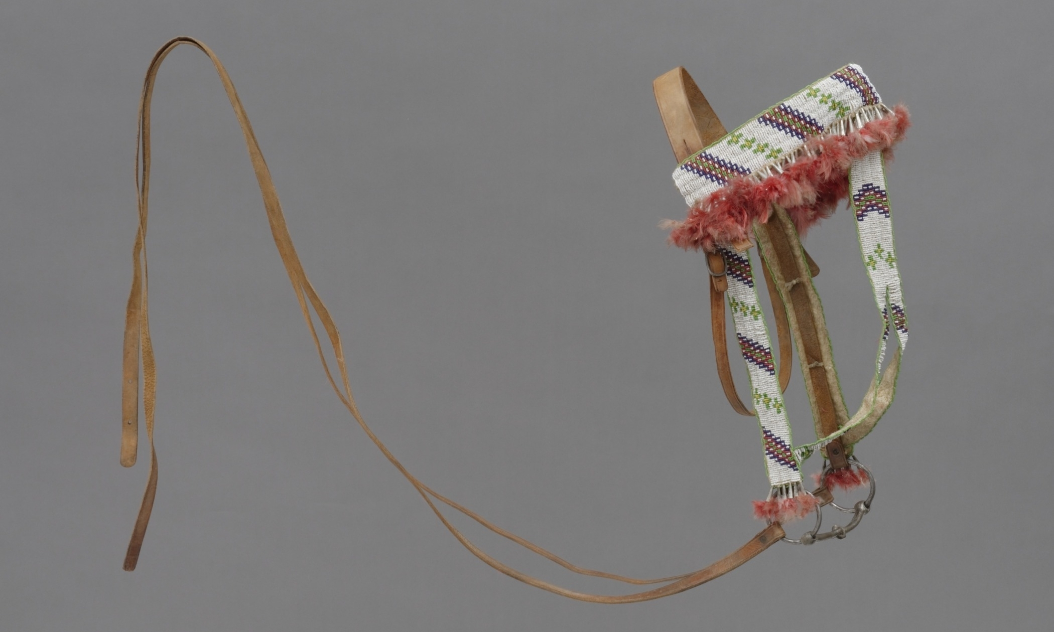 Sioux, beaded leather bridle, collected about 1908. Iron, leather, beads, tin, and feathers. Hood Museum of Art, Dartmouth College: Bequest of Frank C. and Clara G. Churchill; 46.17.9836.