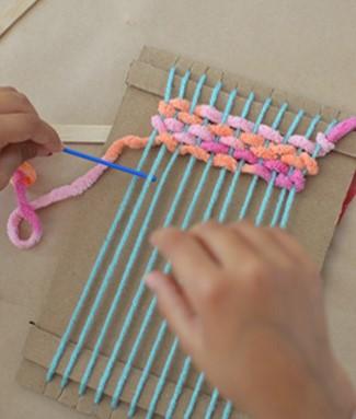 Image 32 Weaving on Loom.jpg