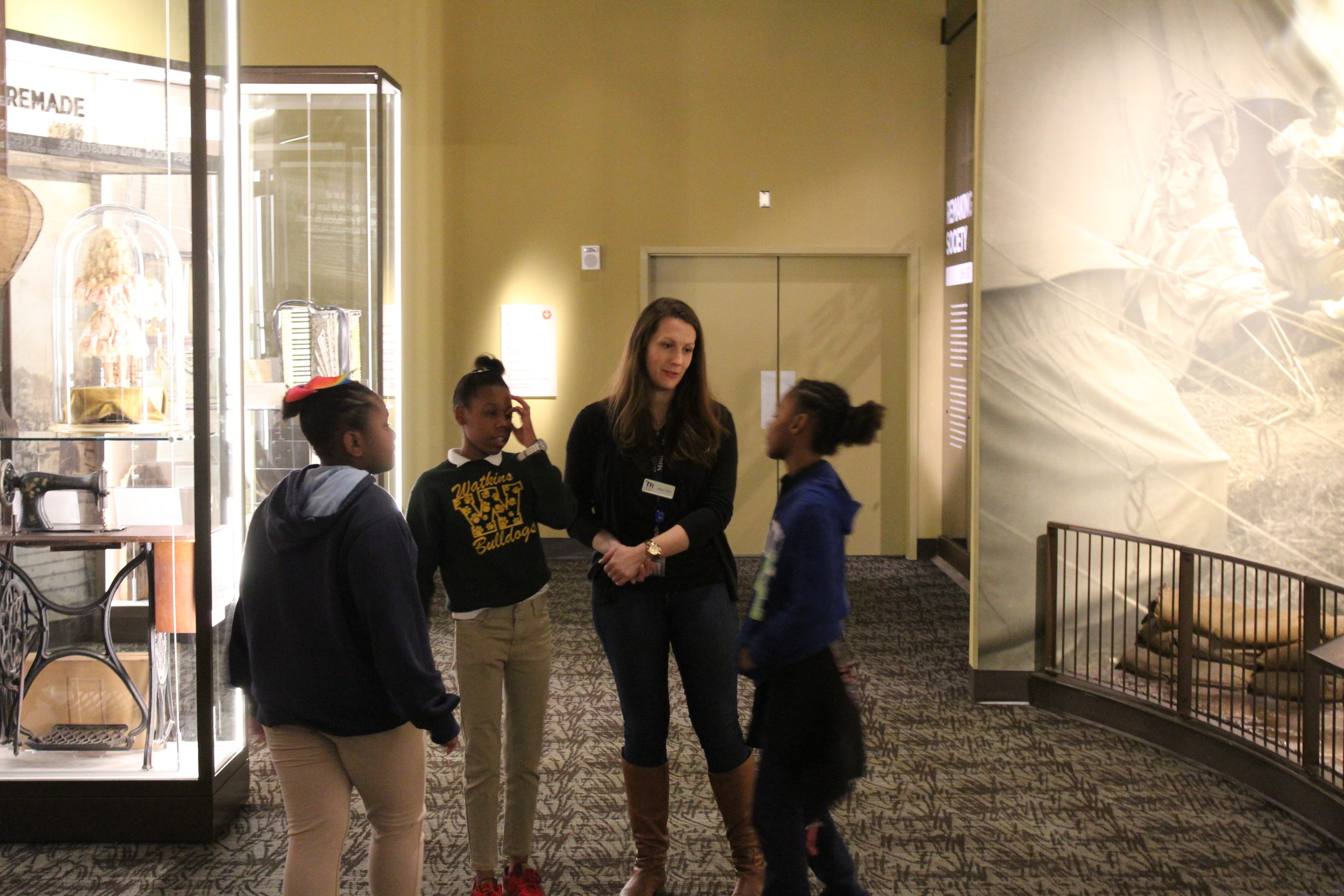 Allison engaging with students from Watkins Elementary School during a field trip.