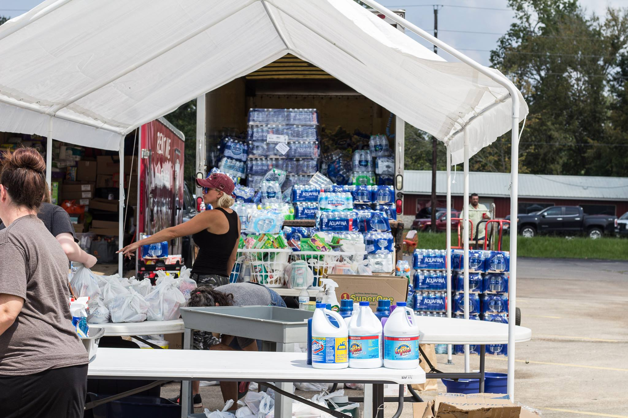 Shylo Eckstrom helps organize efforts to unload trucks that are full of water cases. Photo by Kim Northfield.