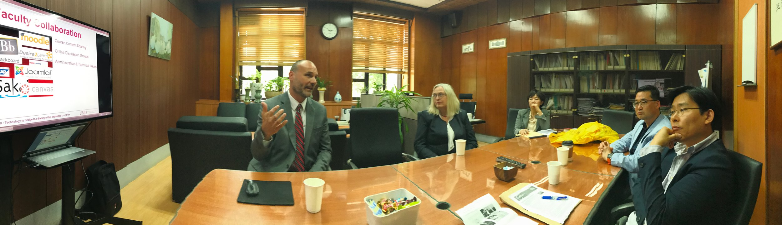 Director of Information Technology Jason Davis explains how the tools of technology can serve as a bridge connecting learning across cultures and countries in a presentation to the Dean of Academic Affairs at Kyung Hee University. Photo courtesy of John Hatcher.