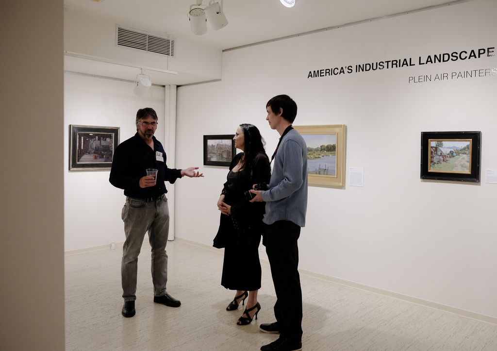 Andy Evansen (left) chats with art enthusiasts at the reception. Photo courtesy of Sharon Mollerus.
