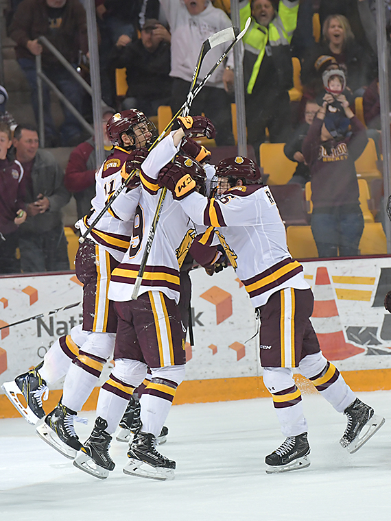 UMD celebrates after a third period game tying goal