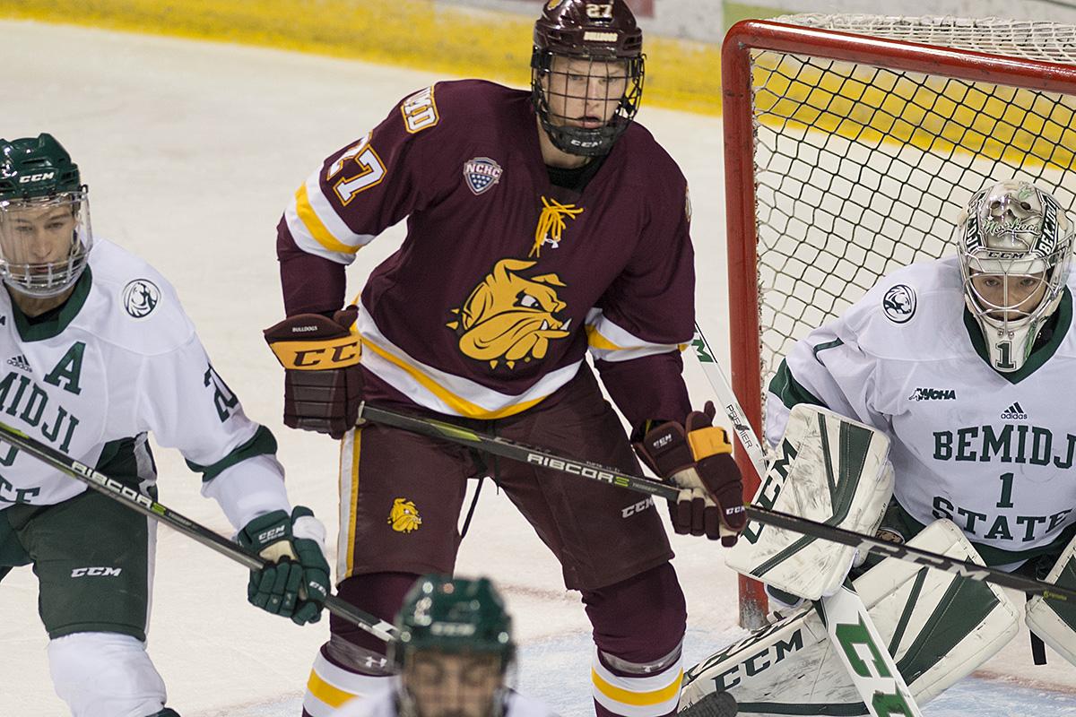 Sophomore forward Riley Tufte battles for position in front of the net