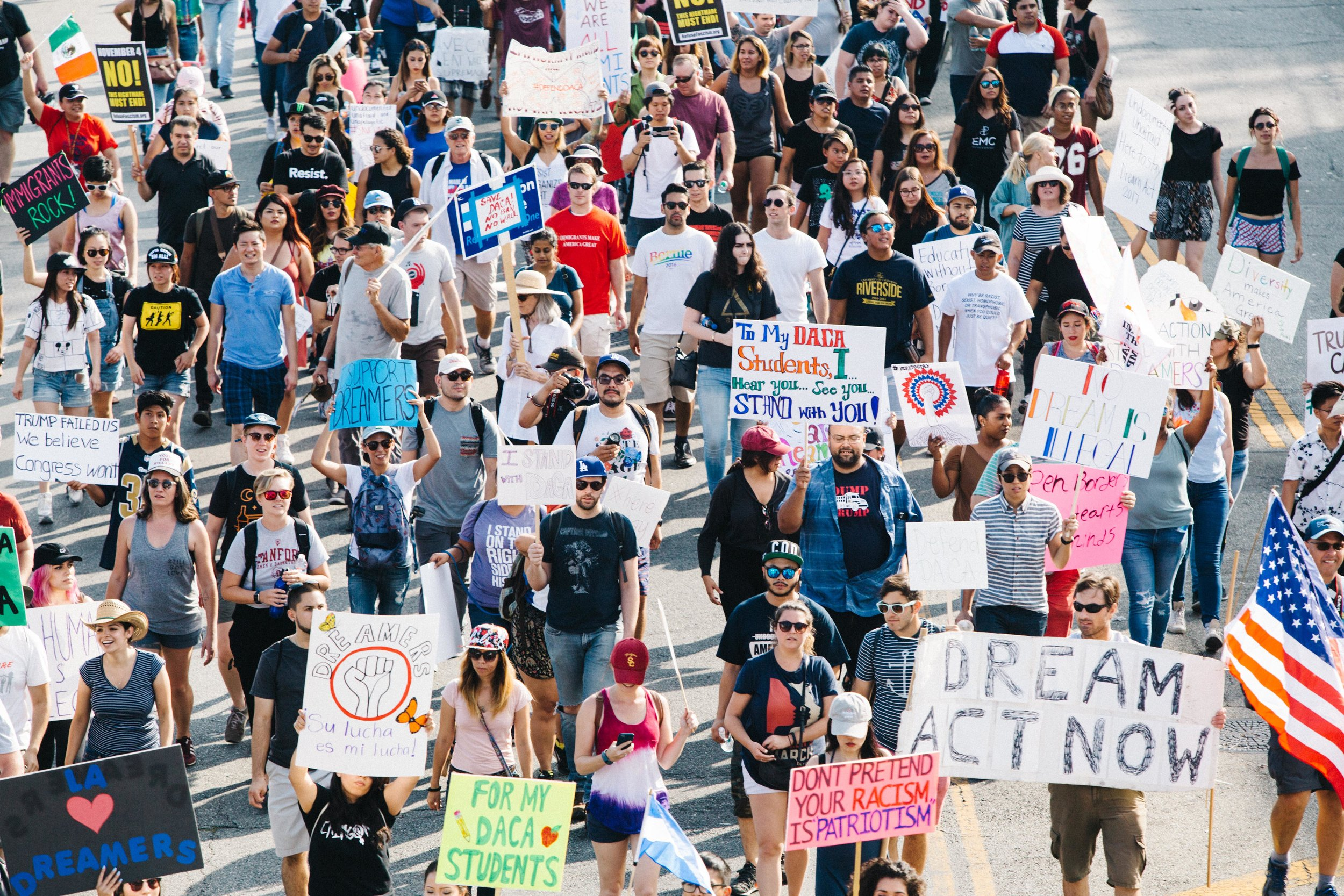 People march in the streets of Los Angeles calling for the end of surveillance, deportations and criminalization of undocumented people.  Photo  by Molly Adams