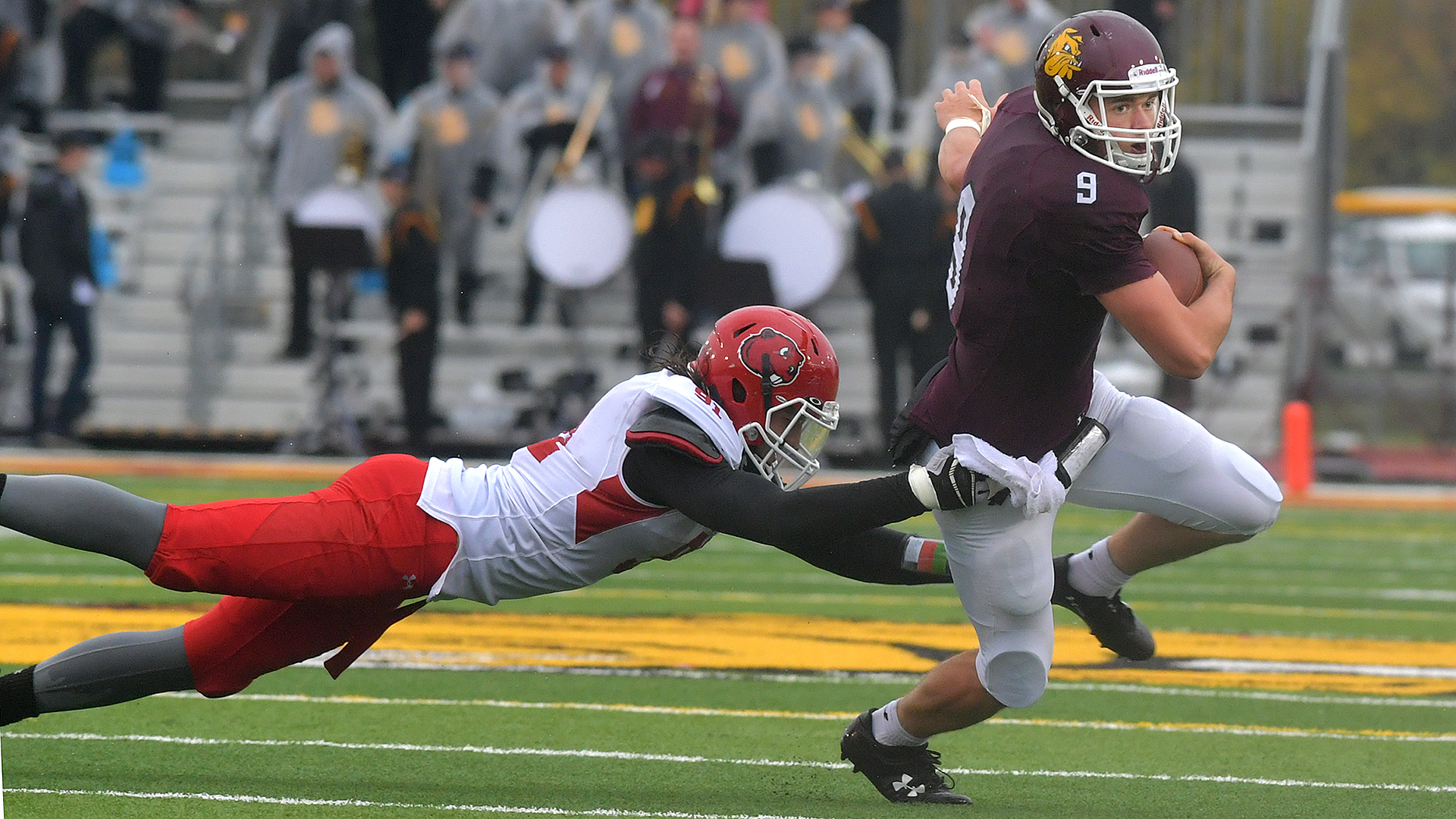 Red-shirt freshman quarterback John Larson escapes a Minot State defender