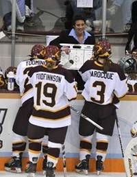 Miller coaching UMD women's hockey prior to the university's decision to terminate her contract. Photo courtesy of the UMD athletic department.