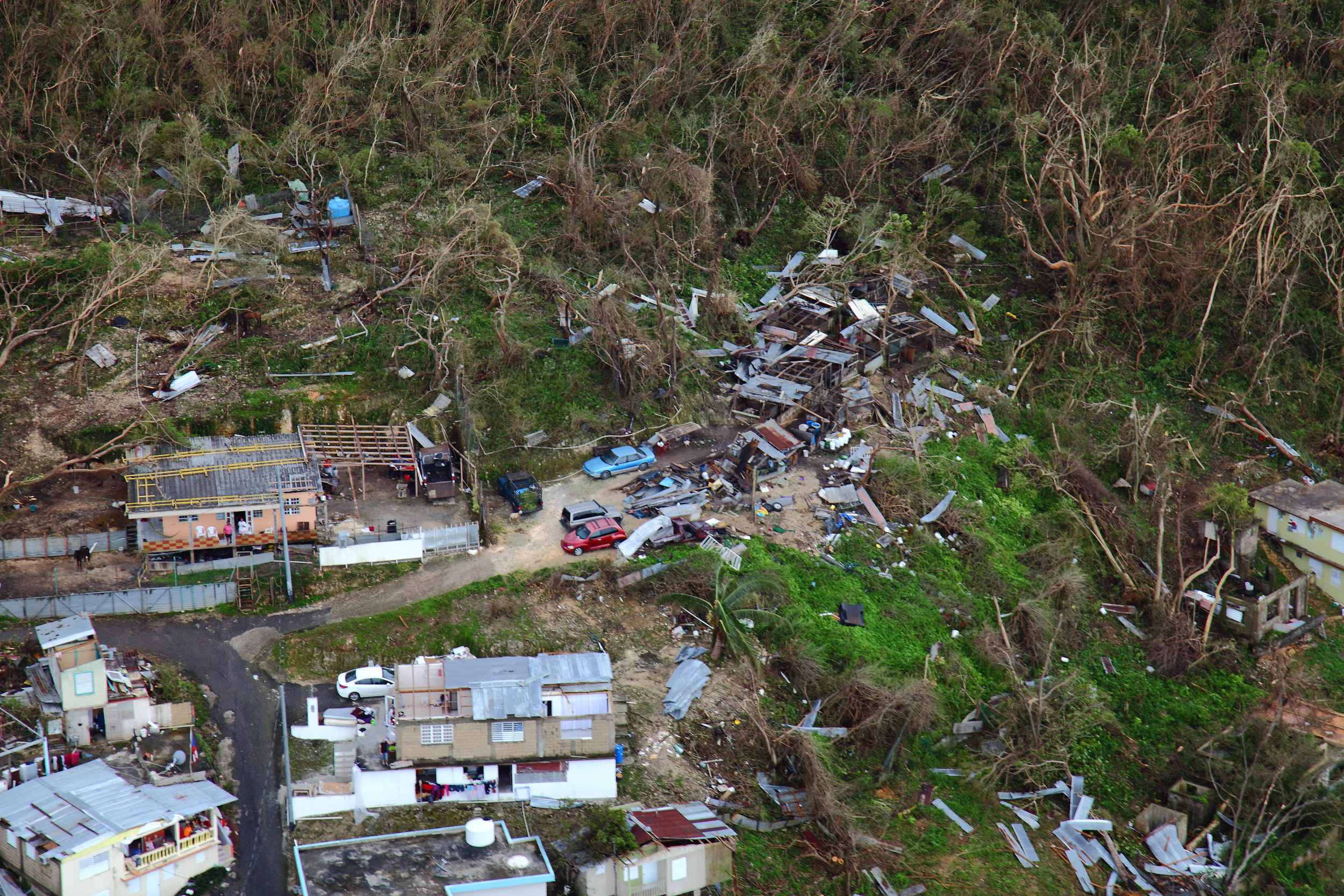 Homes lay in ruin as seen from a U.S. Customs and Border Protection, Air and Marine Operations, Black Hawk during a flyover of Puerto Rico after Hurricane Maria September 23, 2017. Photo by Kris Grogan .