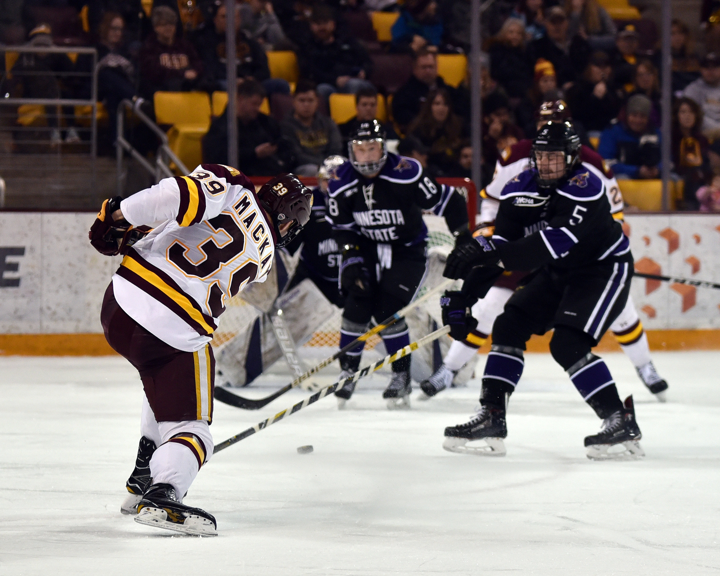 Junior forward Parker Mackay fires a shot at the Mankato net. Photo courtesy of Terry Norton