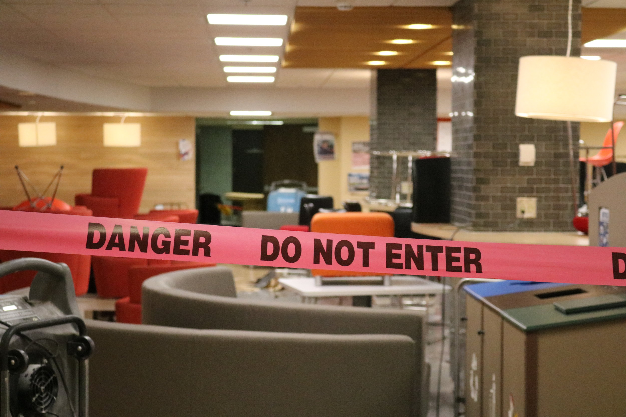 Red caution tape blocks off the entrance into the Ven Den on Feb. 7. Photo by Samantha Church