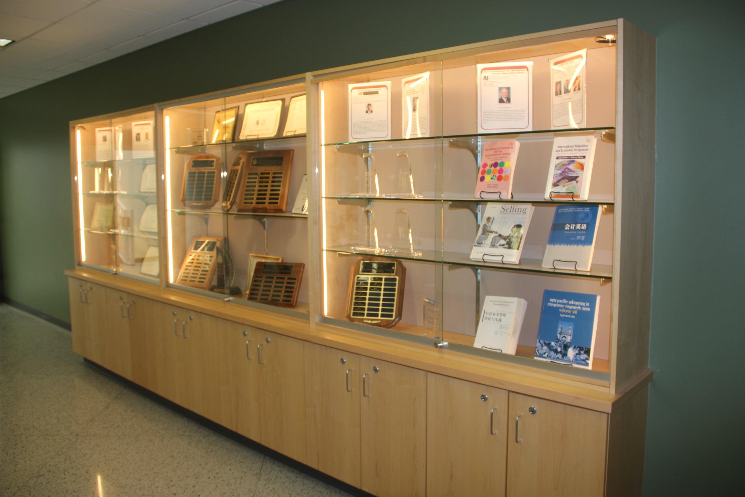 LSBE award display cases holding twenty-five years of accomplishments.Photo: Tyler Schendel