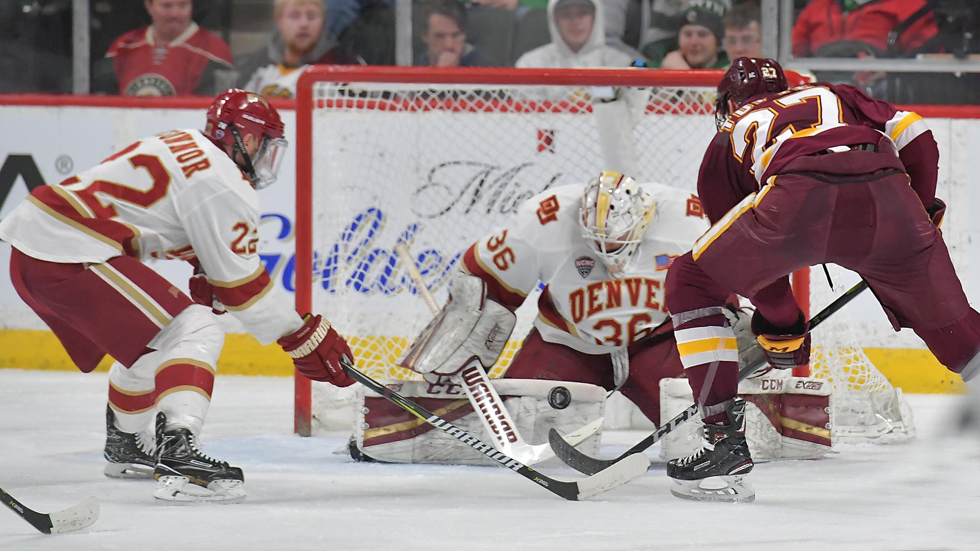 Riley Tufte attacks the net in tonight's game against Denver. Photo courtesy of Brett Groehler
