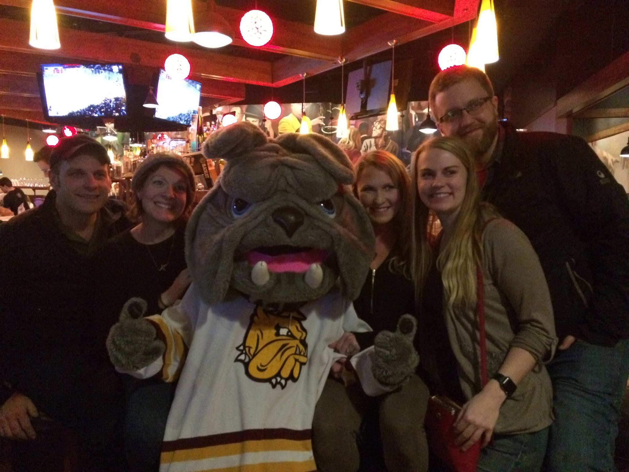 Champ meets with Bulldog fans during a frozen four watch party at Tavern on the Hill last spring  Photo courtesy: UMD Alumni Relations