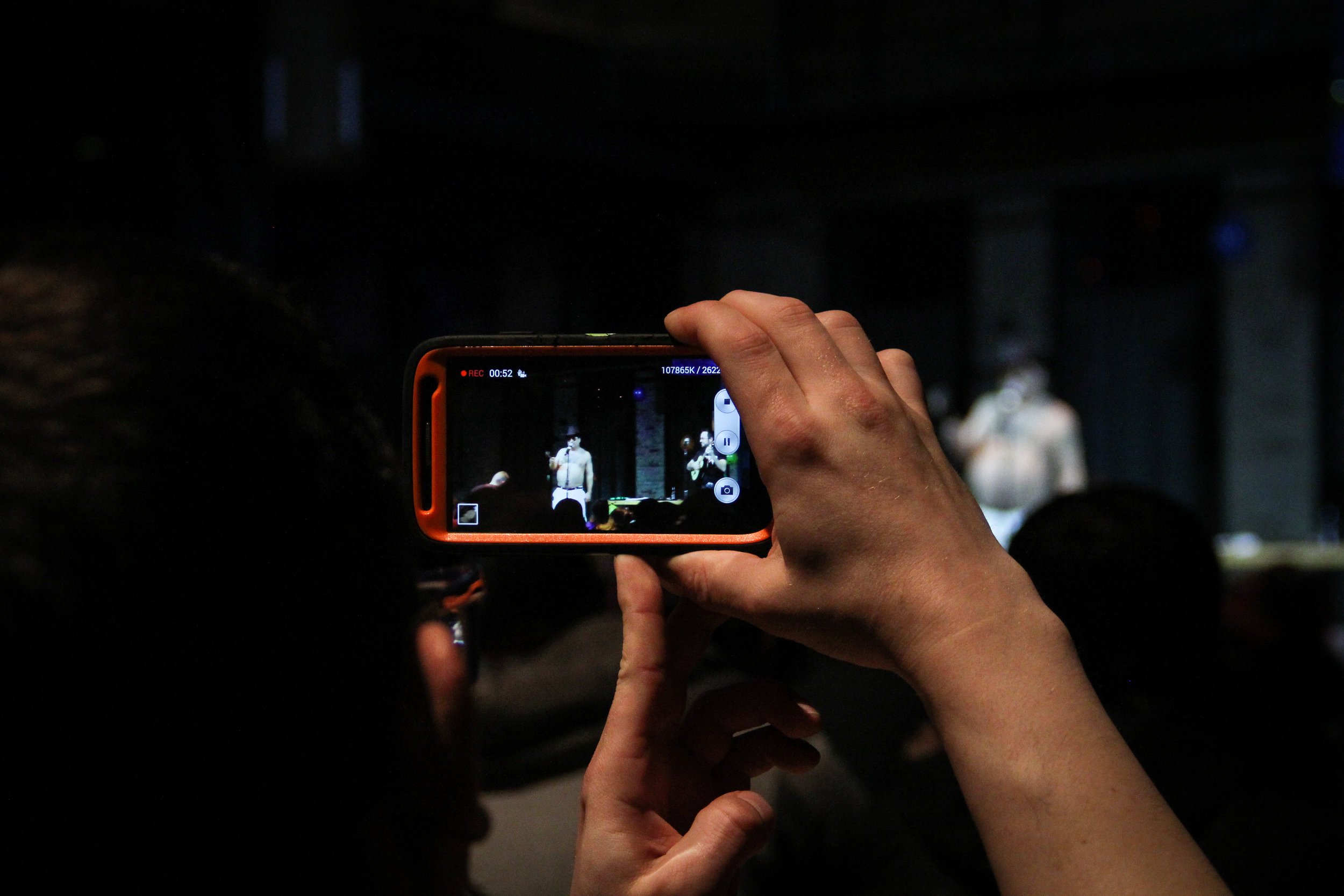 Audience members capturing Patrick Roach. Photo by Krista Mathes