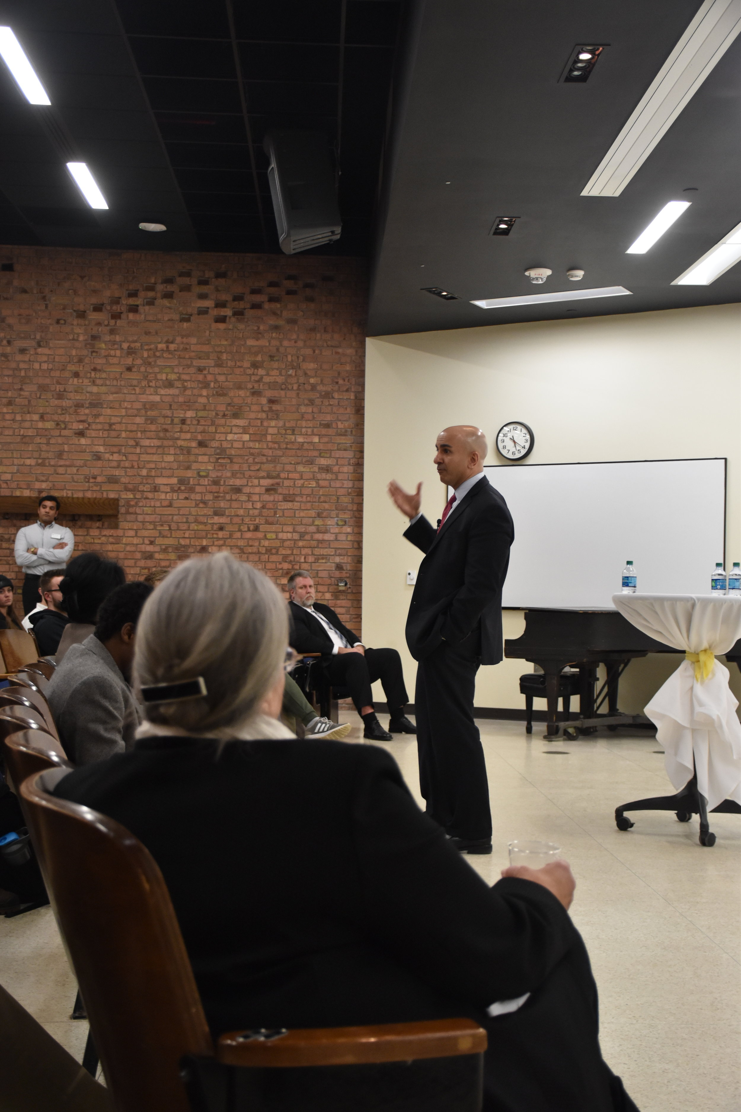 LSBE Dean Amy Hietapelto observes Pres. Kashkari during his recent Q/A forum in Montague Hall. Photo by Connor Shea