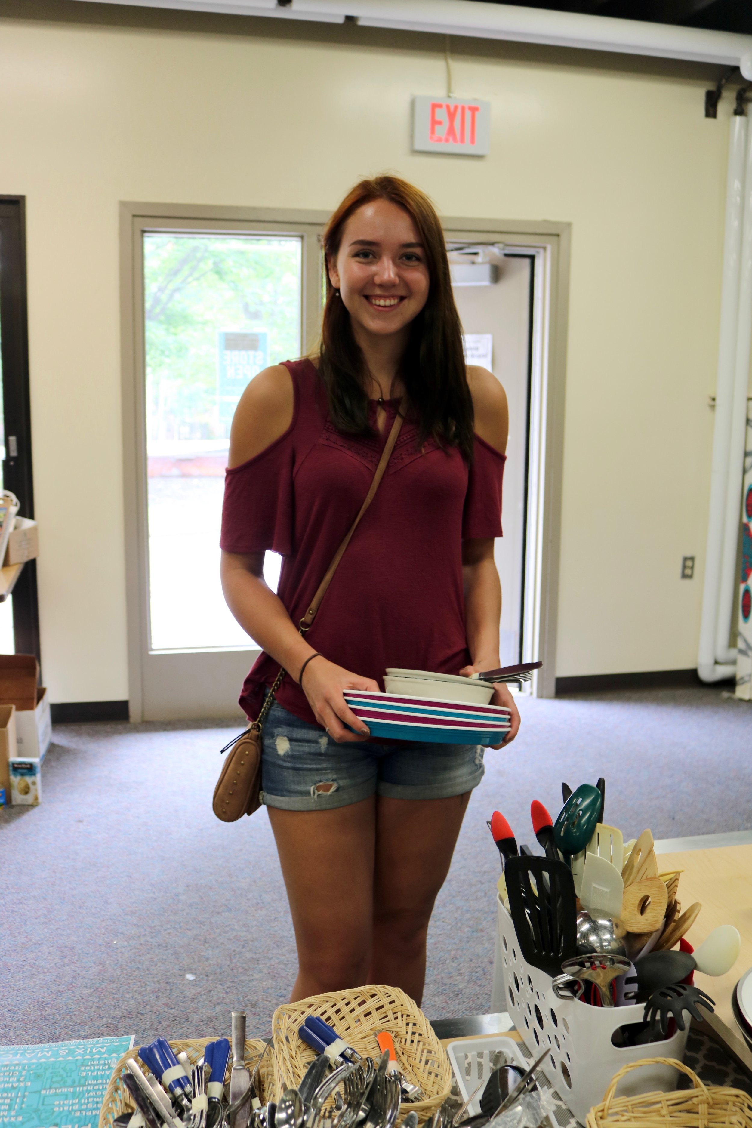 Incoming first year student Rachel Kuhlman was on the hunt for kitchen items and bed risers at the Free Store on Aug. 21, 2018 at Heaney Service Center. She was glad to have these available for her. Photo by Brianna Taggart