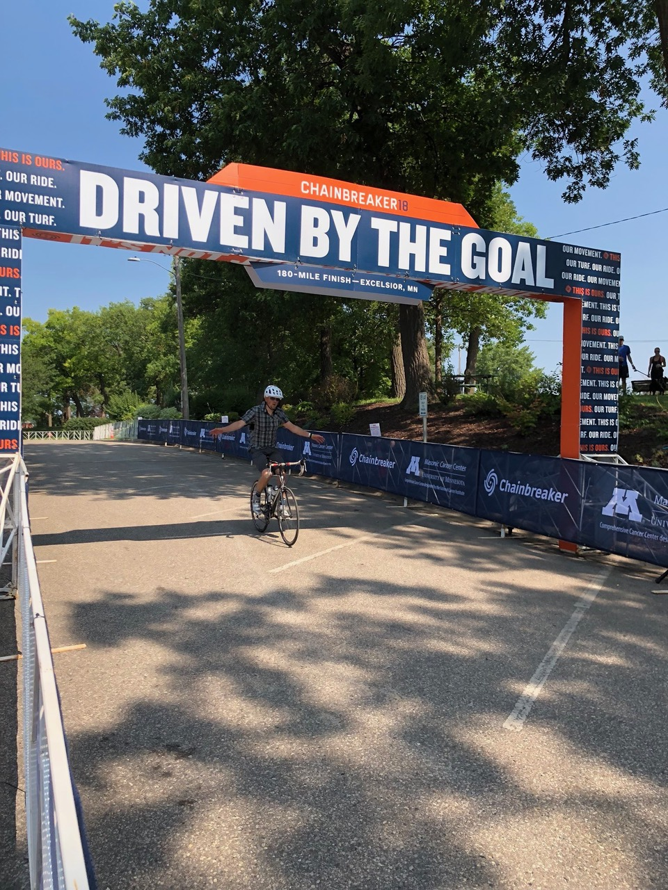 Professor in the College of Pharmacy, David Stenehjem, at the finish line for the Chainbreaker Ride on Aug. 12, 2018. Stenehjem rode all 180 miles on his bike for the Chainbreaker Ride for one of his many cancer fundraising events. Photo courtesy of David Stenehjem