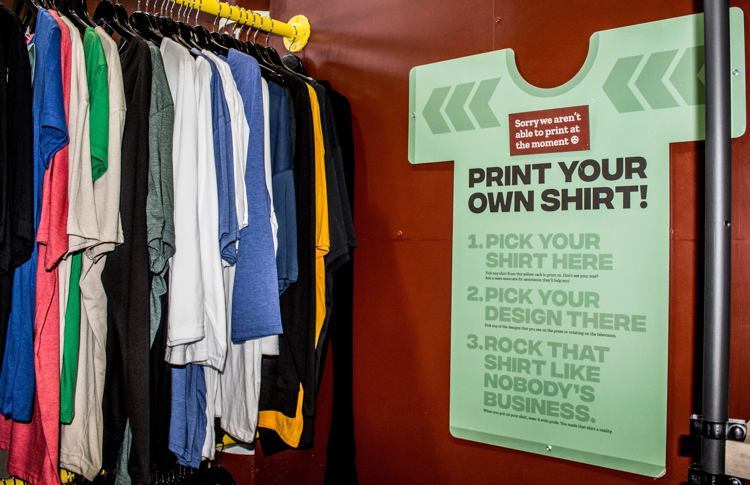 'Print Your Own Shirt' sign on the wall of Flagship's store. Photo courtesy of Justin Flesher.