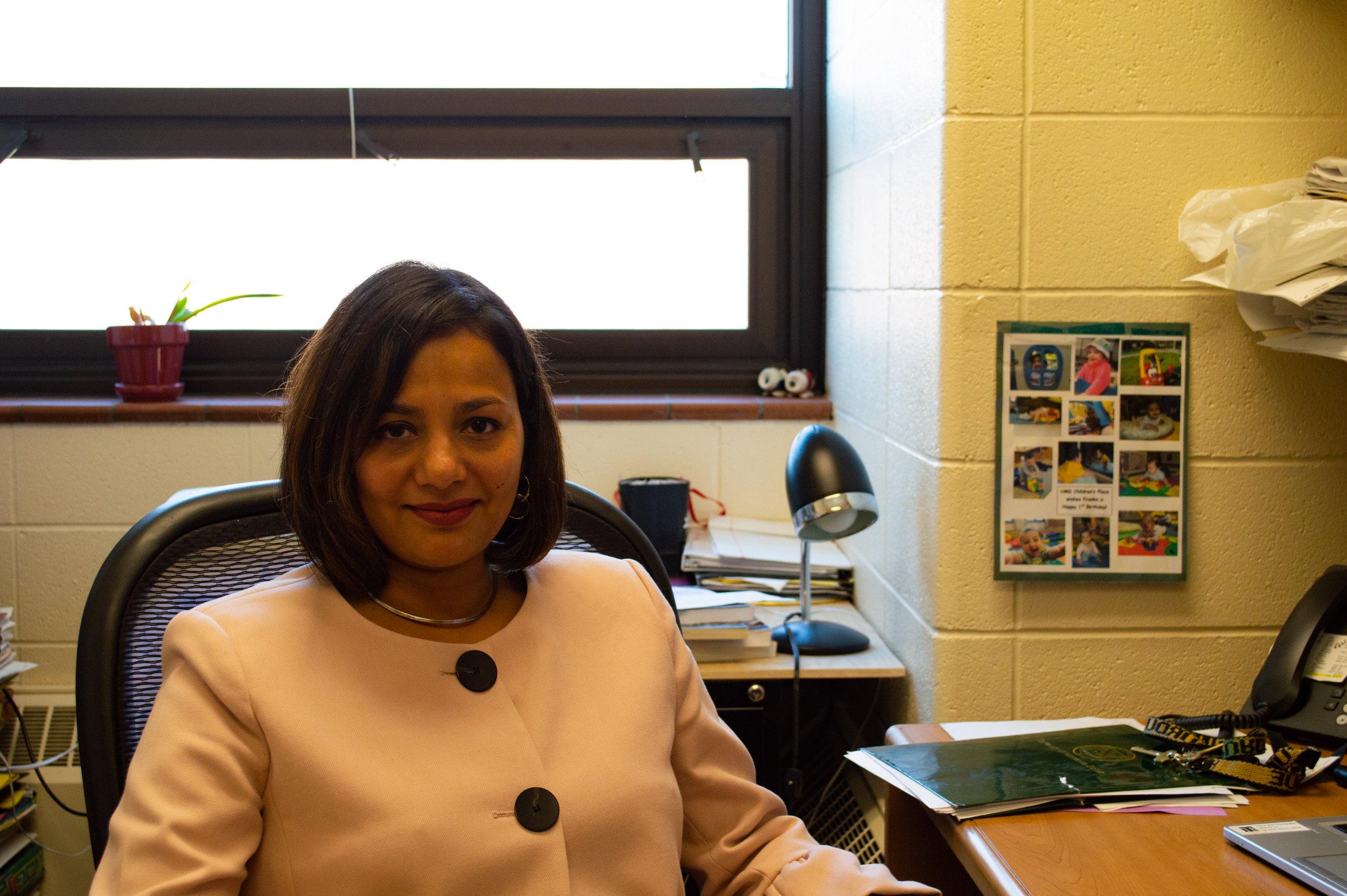 Professor Rebecca de Souza sitting in her office. Photo by Jake Barnard.