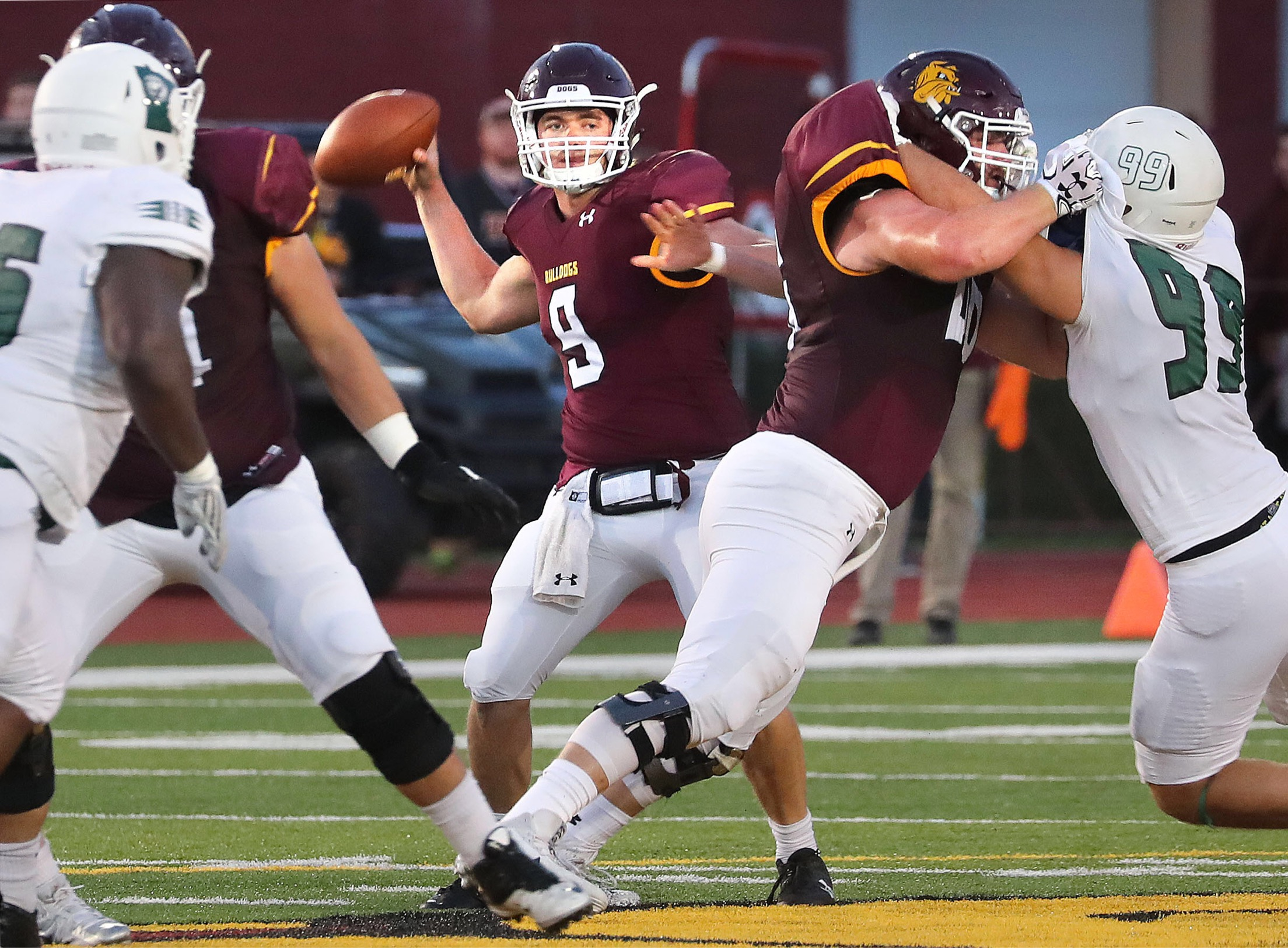 Sophomore QB, John Larson (No. 9) ended the game against Bemidji State with 19 completed passes and 242 yards thrown. Photo by: Bob King
