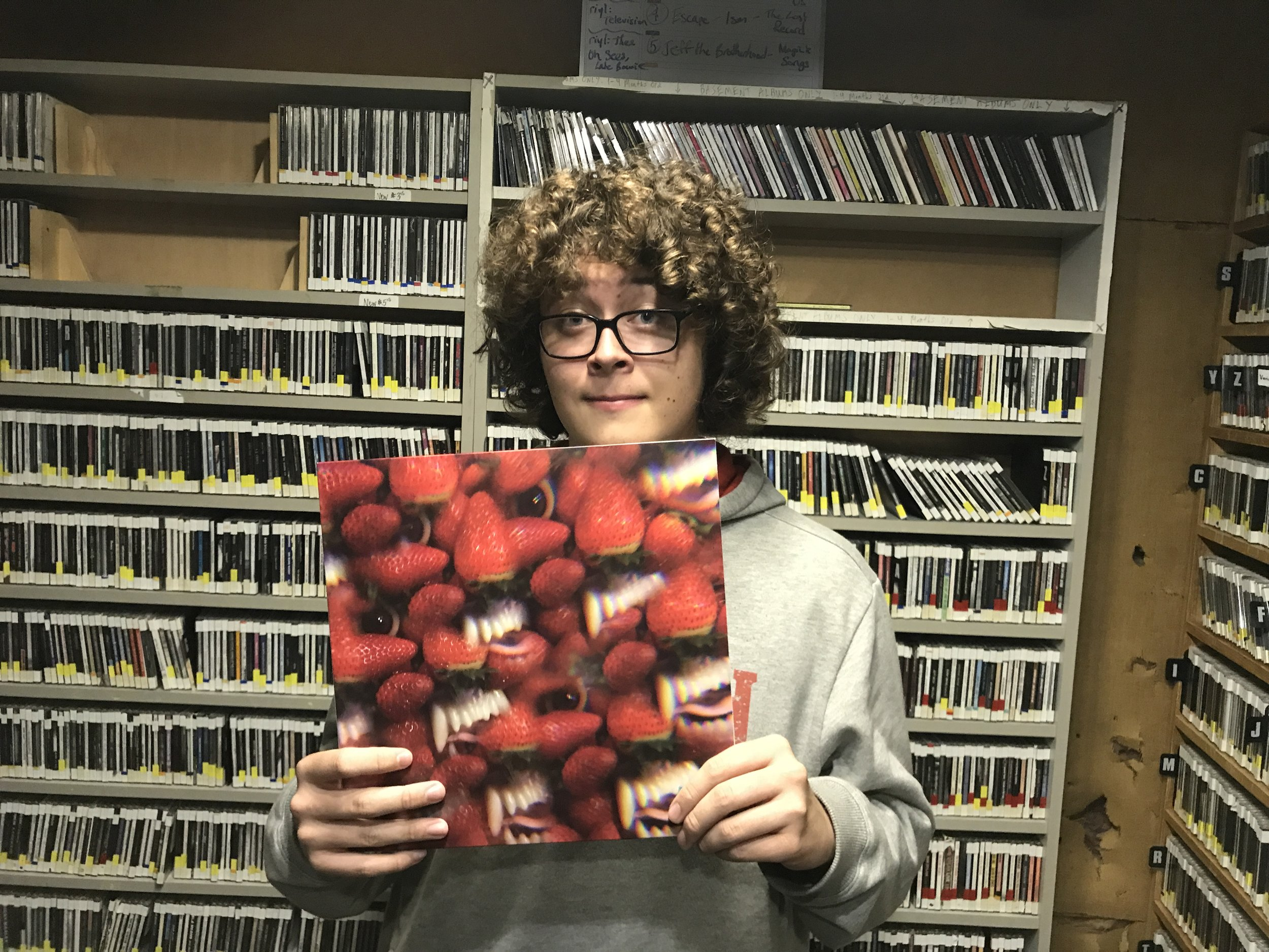 Finnegan on occasion will play a vinyl record from his own collection on air. Photo by: Vincent Harvieux