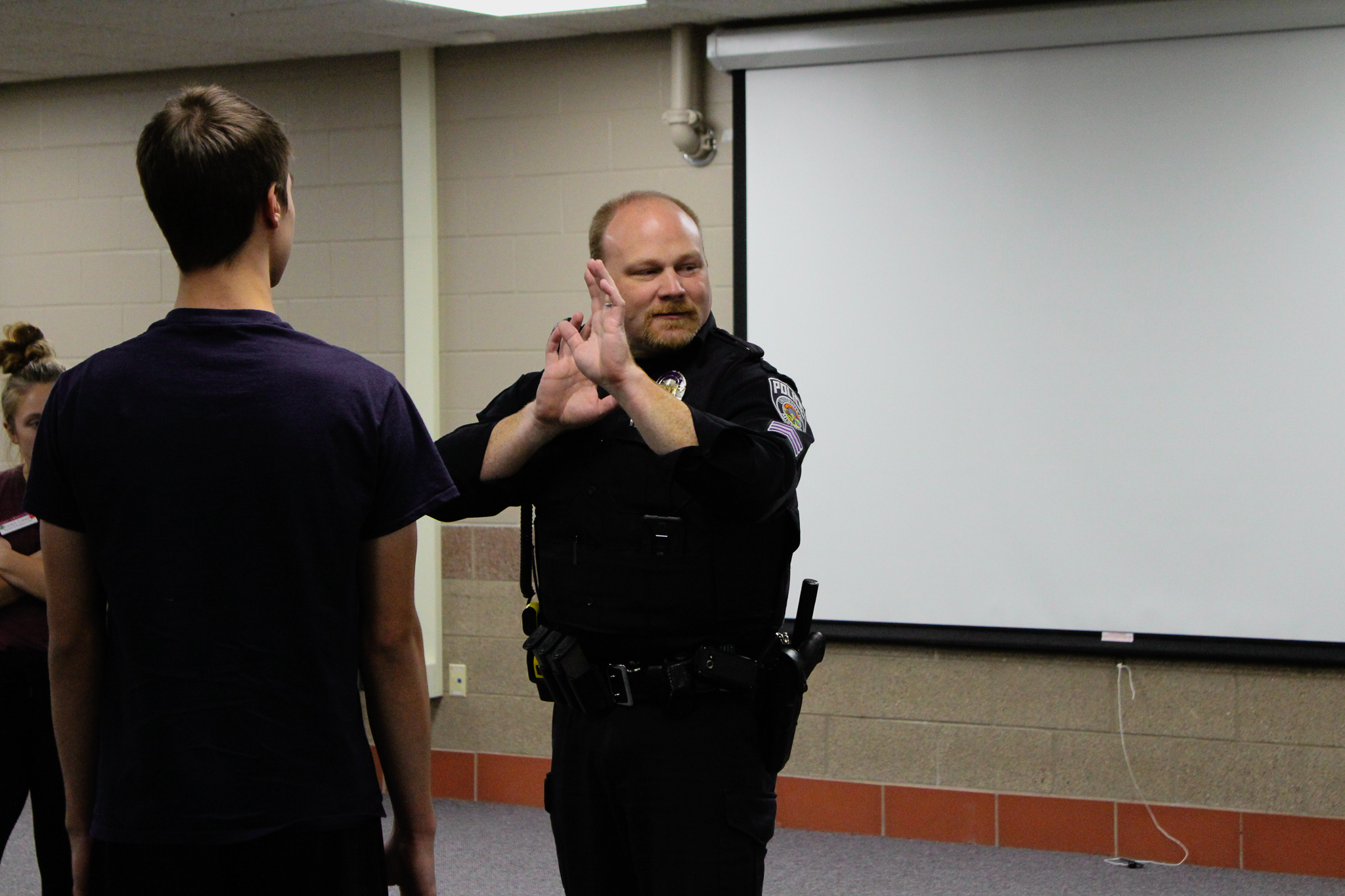Sgt. Chris Shovein with the UMDPD demonstrates self-defense techniques. Photo by: Morgan Pint