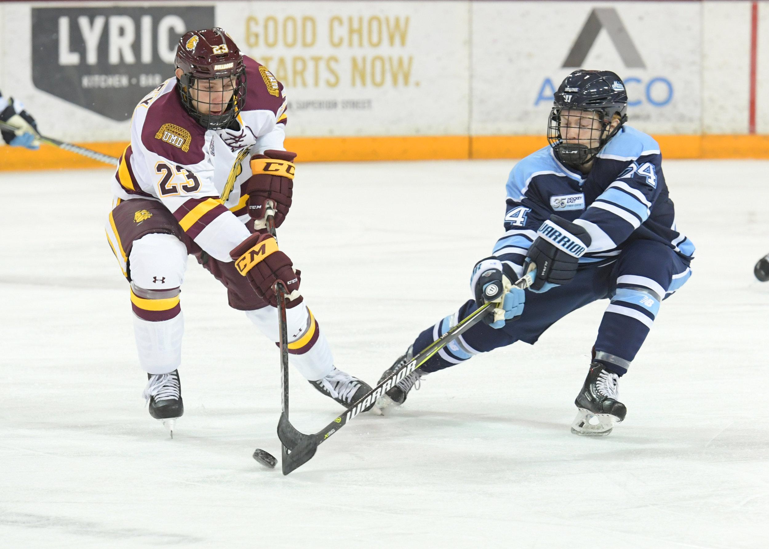 Sophomore Nick Swaney battles the Black Bears down the ice. Photo courtesy of UMD Athletics