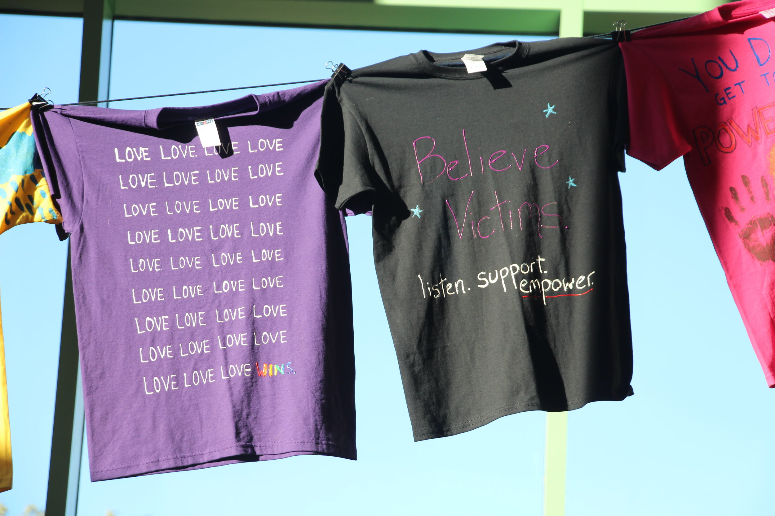The T-shirts have messages of love and support for victims and survivors. Photo by Ren Friemann