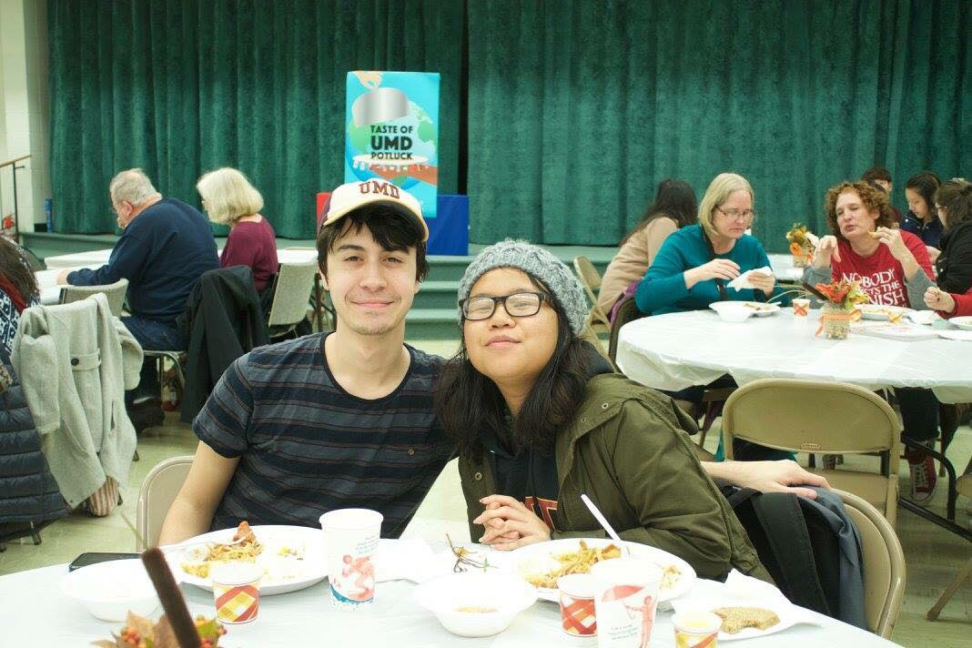 Dominic Bisogno and Suenary Philavanh at the 2017 potluck. It was Philavanh's second year at the event. The first year she was a chef with her student organization Asian Pacific American Association. The second year she went to support the event. Photo courtesy International Club