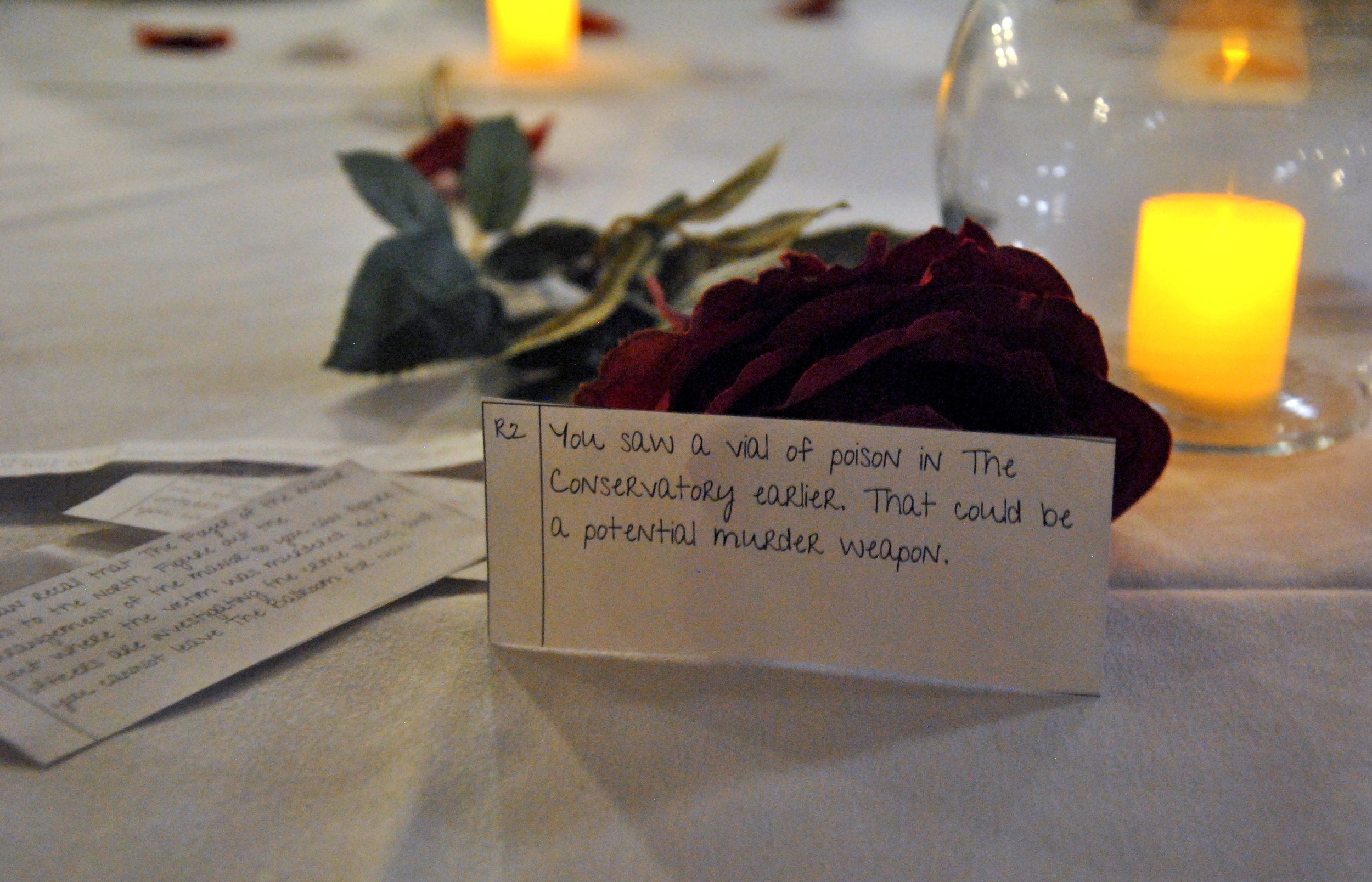 Some of the many clues at BSA's Murder Mystery event in the Kirby Ballroom on Nov. 2, 2018. Each dinner guest was given a clue when they entered the ballroom. Photo by Rebecca Kottke
