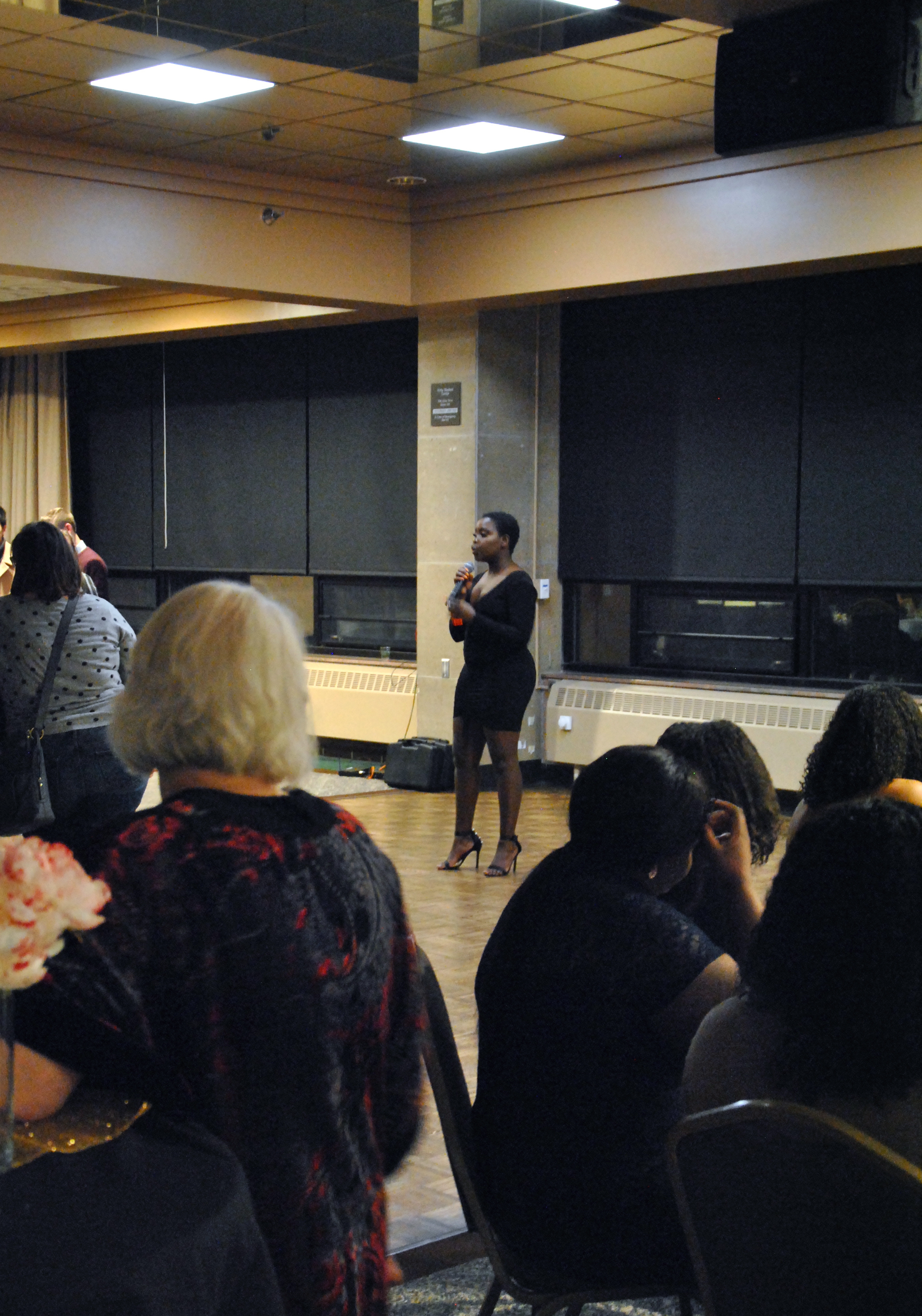 Doreen Nyamwaya, a BSA member, announcing the beginning of Murder Mystery on Nov. 2, 2018, in Kirby Ballroom. Nyamwaya remained one of the main announcers to help guide the game throughout the evening. Photo by Rebecca Kottke